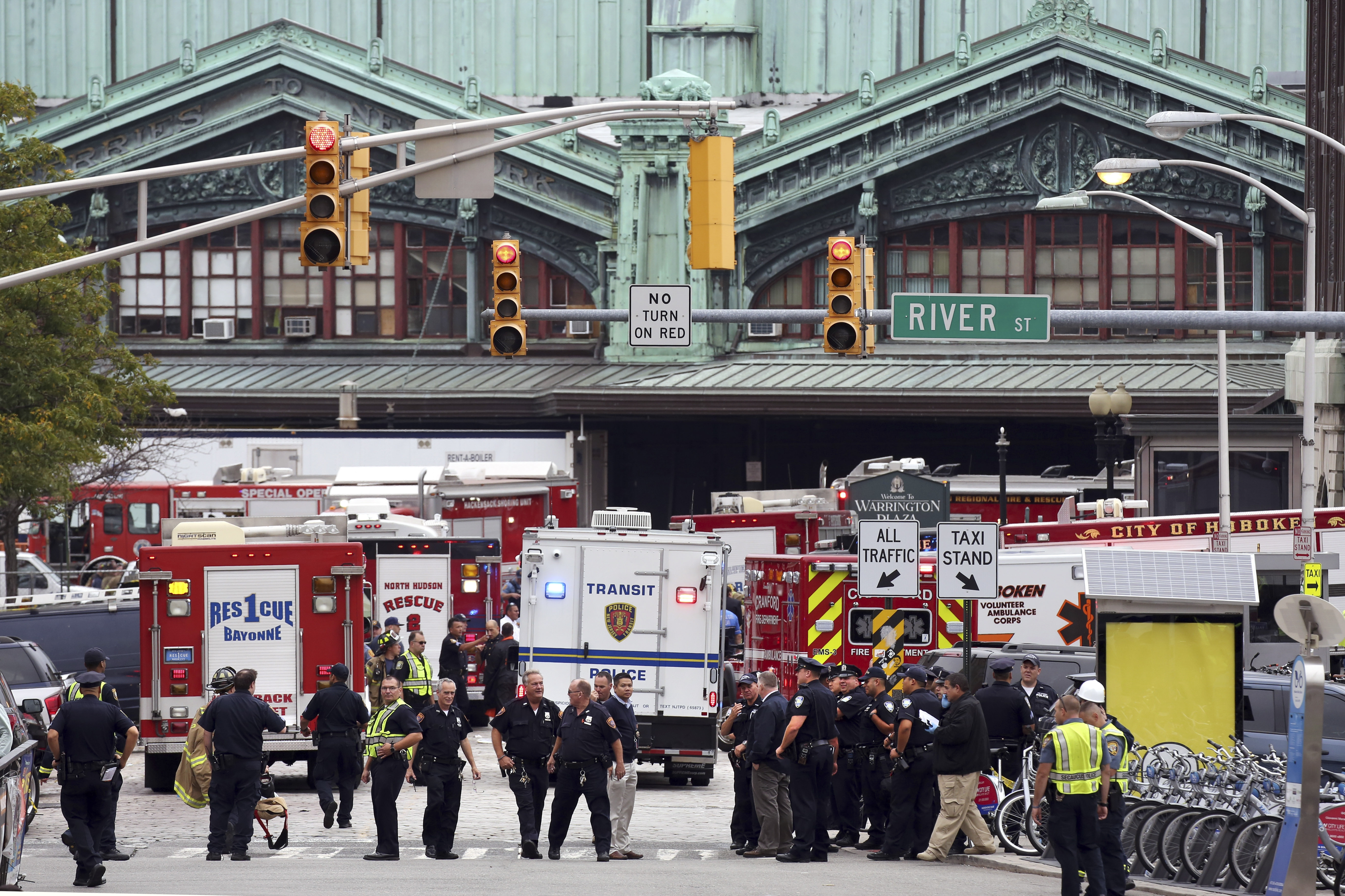 Emergency responders outside Hoboken Terminal, where a commuter train crashed into a station, in Hoboken, N.J., Sept. 29, 2016. The train crashed during the Thursday morning rush, killing at least one person and injuring about 100 people, a number of them seriously, the authorities said. (Richard Perry/The New York Times)