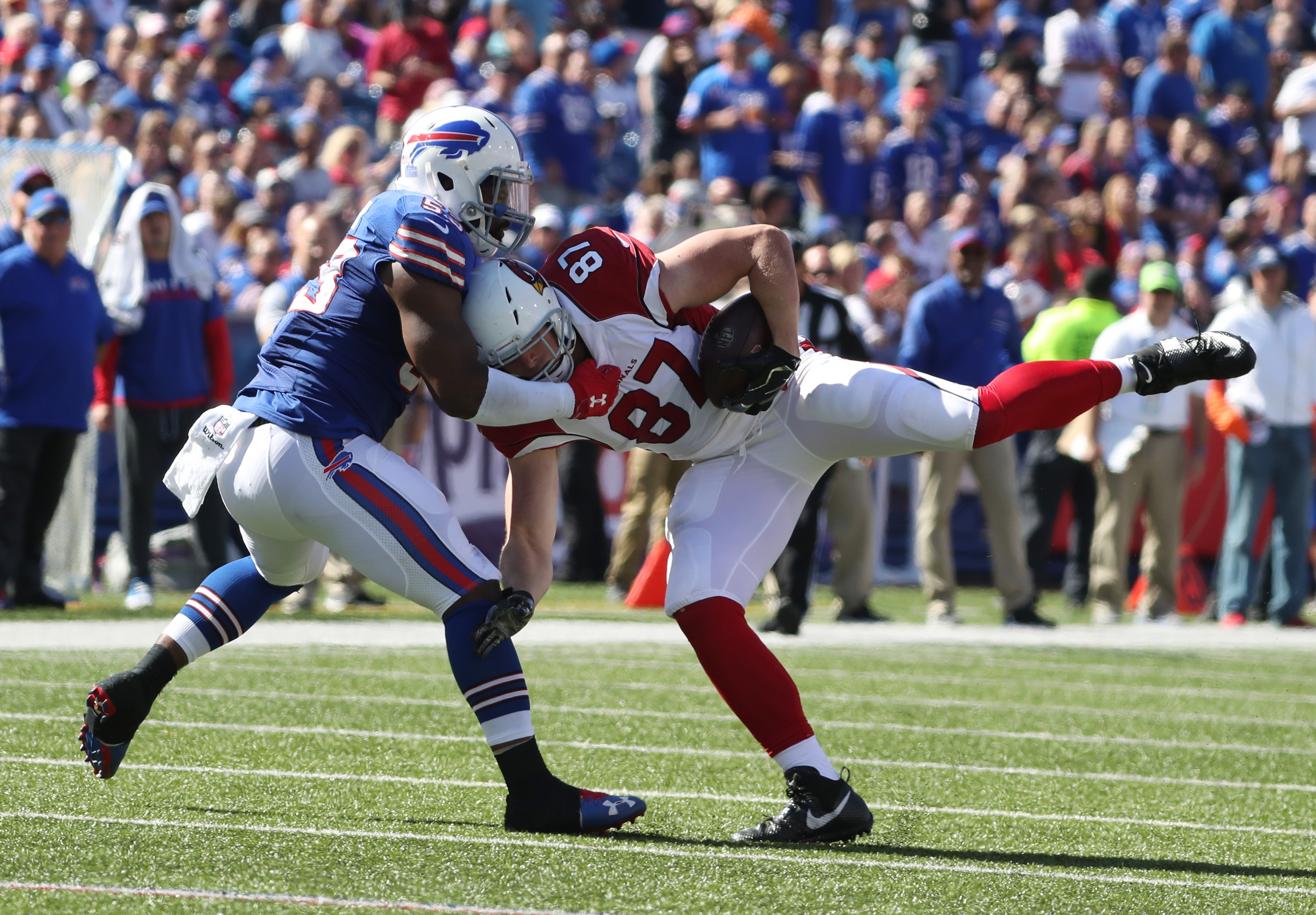 Buffalo Bills linebacker Zach Brown brings down Arizona Cardinals tight end Troy Niklas for one of his team-leading 34 tackles. (James P. McCoy/Buffalo News)