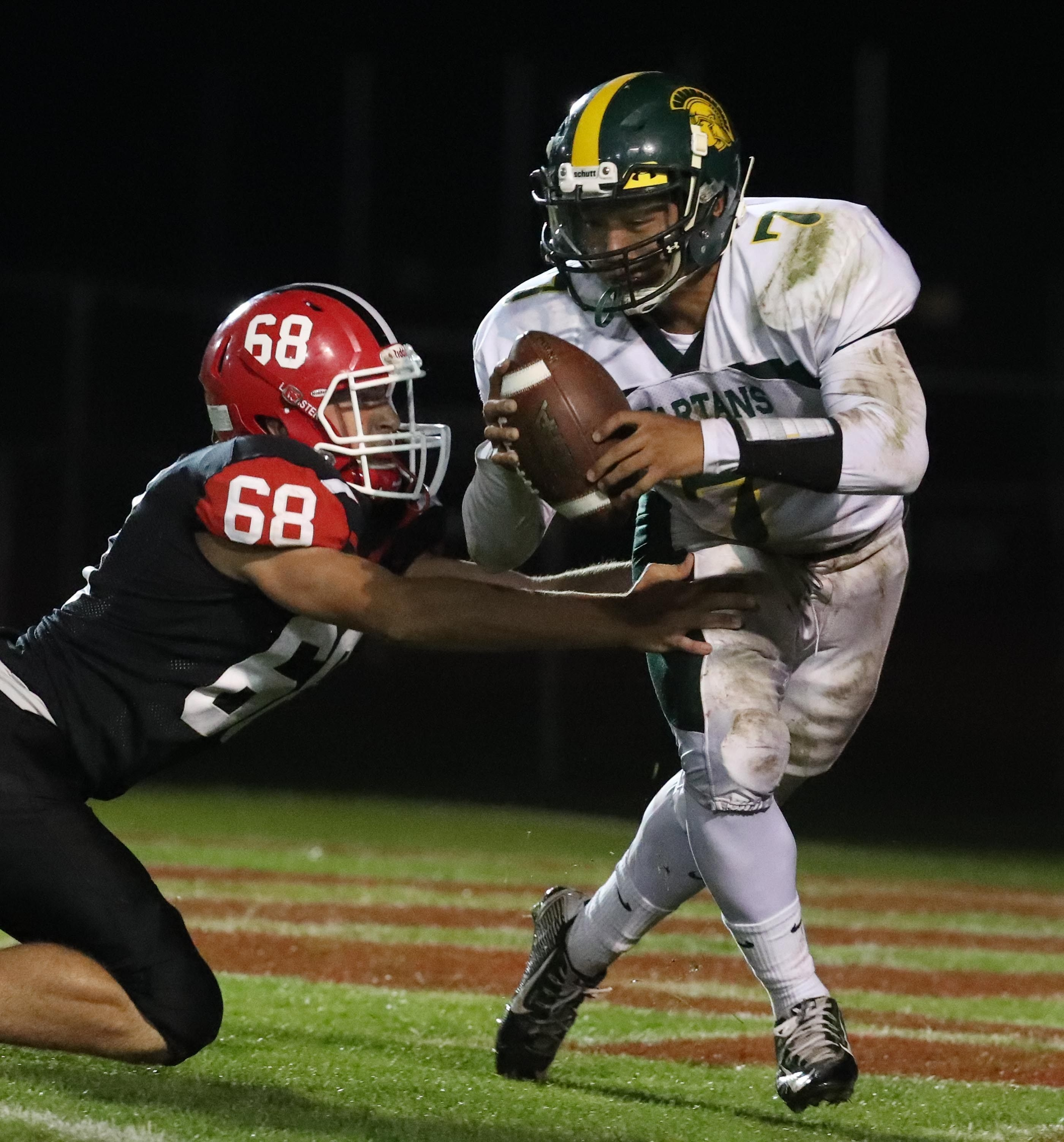 Lancaster's  Jacob Michalski pressures Williamsville North's Jason Hwang during last week's Class AA matchup.