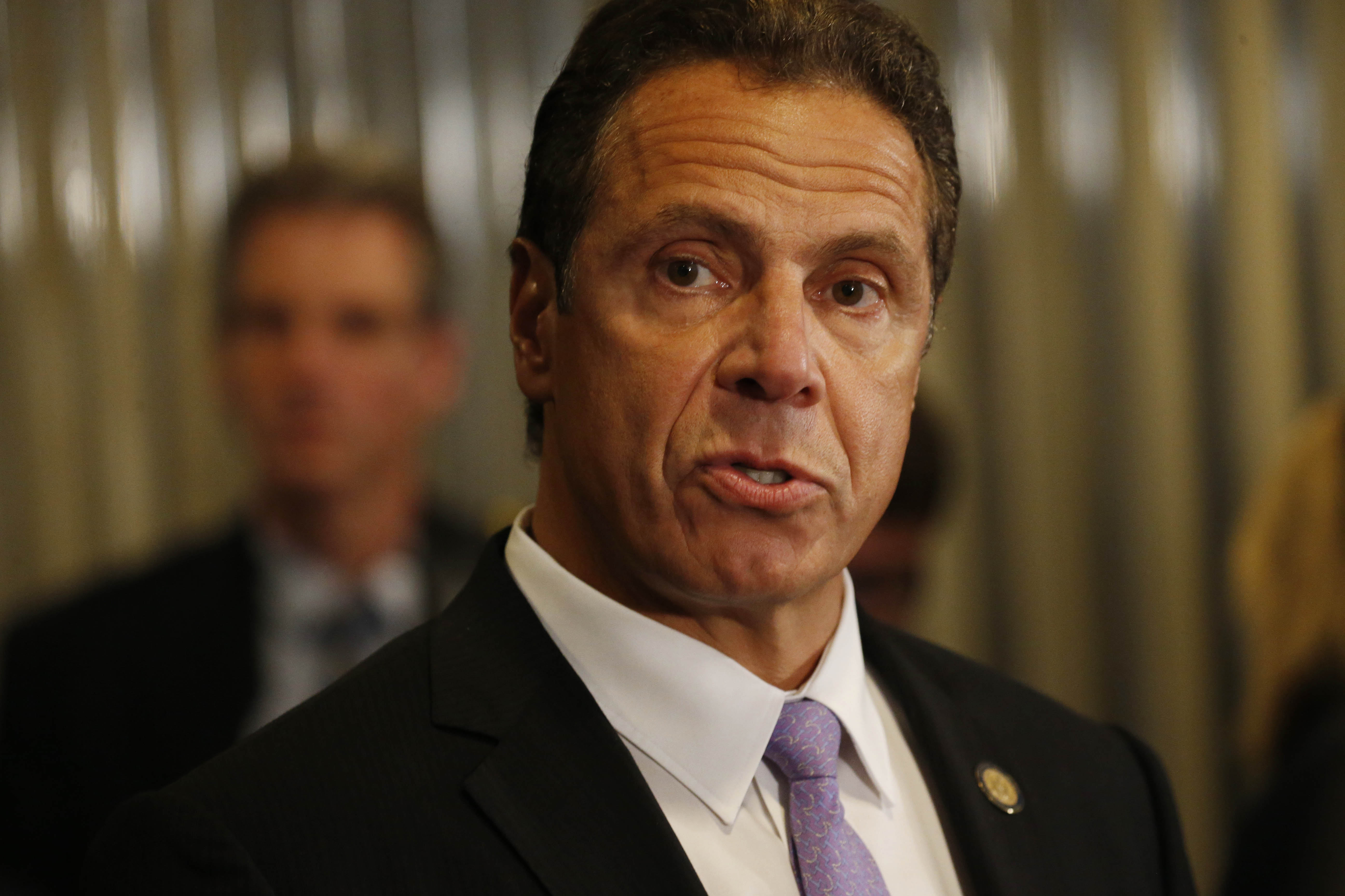 Gov. Andrew Cuomo answers questions from reporters on Sept. 23, 2016 in Buffalo. Cuomo visited Buffalo the day after nine people were arrested in a public corruption probe involving Cuomo's biggest Upstate New York economic development projects. (Derek Gee/Buffalo News)