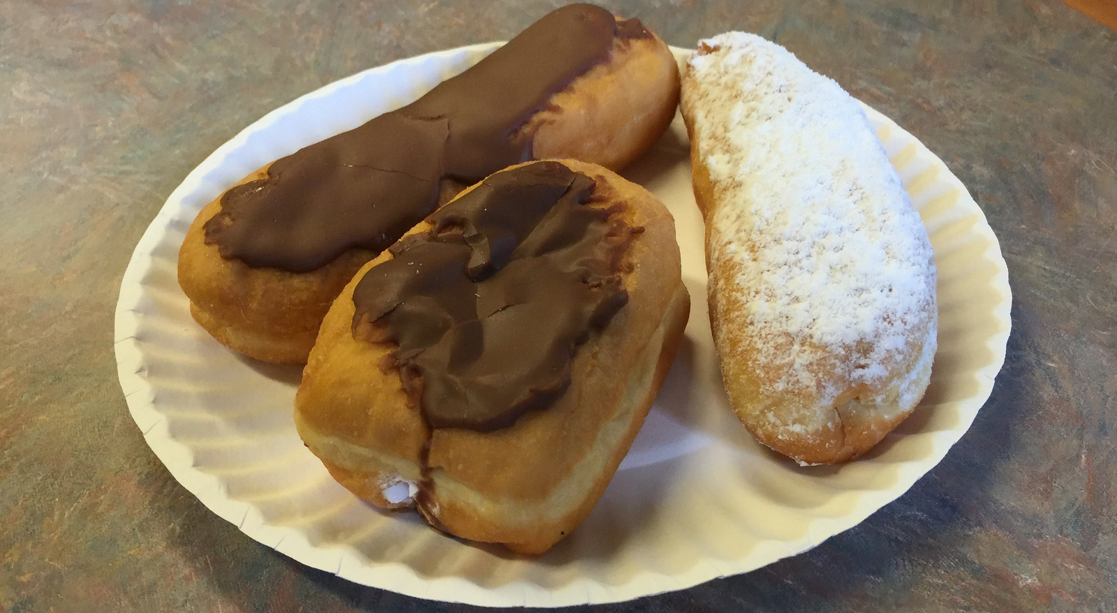 Another look at cream-filled doughnuts from Eileen's Bakery in West Seneca. (Andrew Galarneau/Buffalo News)