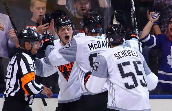 Jack Eichel celebrates his first-period goal for Team North America with Connor McDavid and Mark Scheifele (Getty Images).