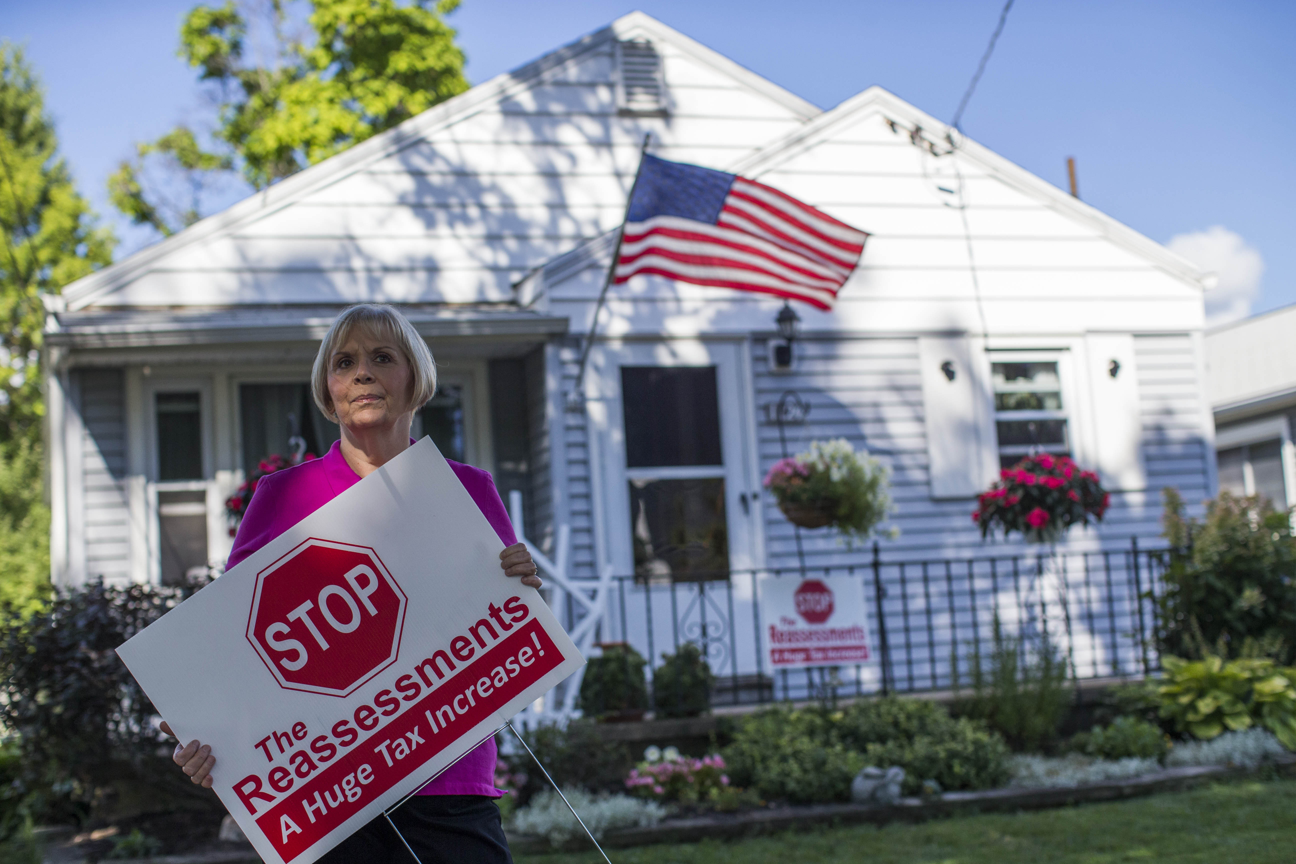 Maribeth Gangloff, who lives in the home she grew up in the Lasalle neighborhood of Niagara Falls, is fighting reassessment which she claims amounts to a tax increase, Tuesday, Aug. 23, 2016.  (Derek Gee/Buffalo News)