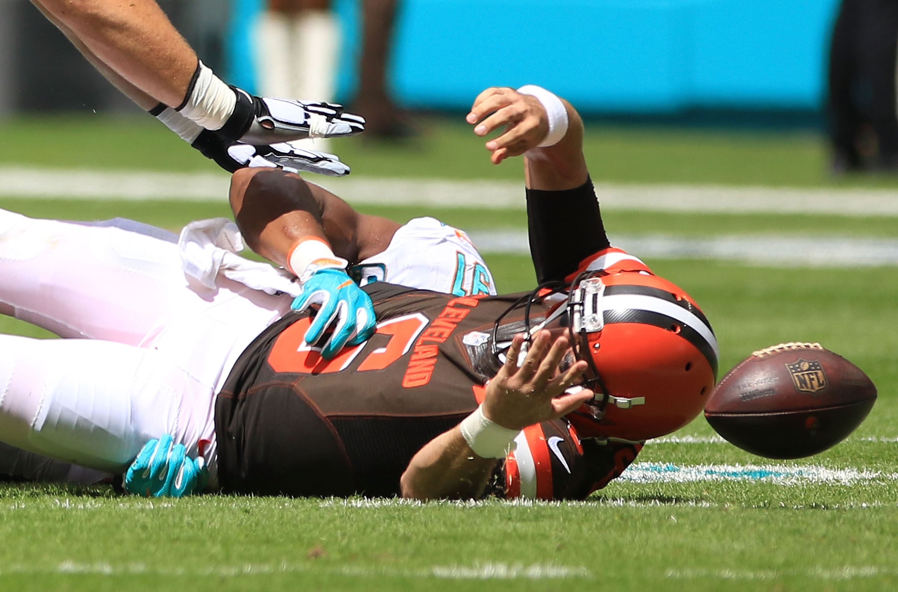 Cody Kessler of the Cleveland Browns fumbles as he is sacked by Cameron Wake of the Miami Dolphins on Sunday. (Getty Images)