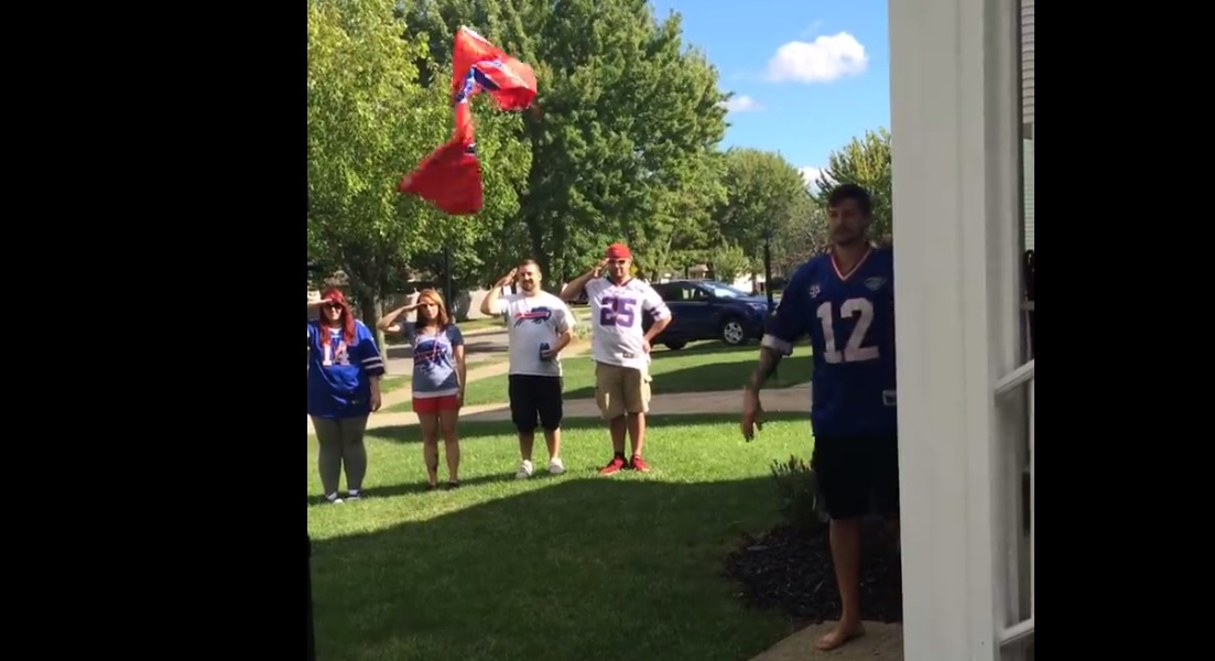 Lou Muscato, wearing the Jim Kelly jersey, tosses the Bills flag away. See the video concocted by Justen Ehrig and Adam Drzyzga reacting to the Bills loss. (Screenshot)