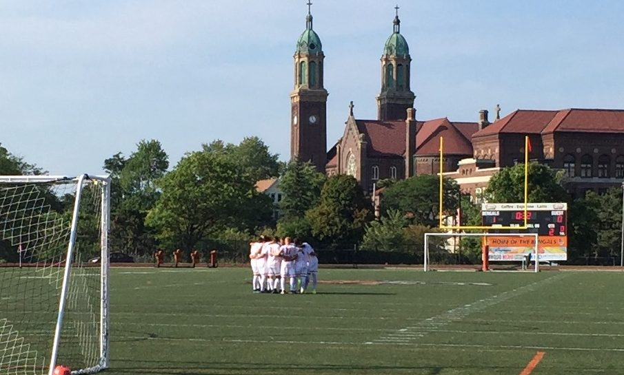 Buffalo State men's soccer huddles before the second half against Medaille. (Ben Tsujimoto/Buffalo News)