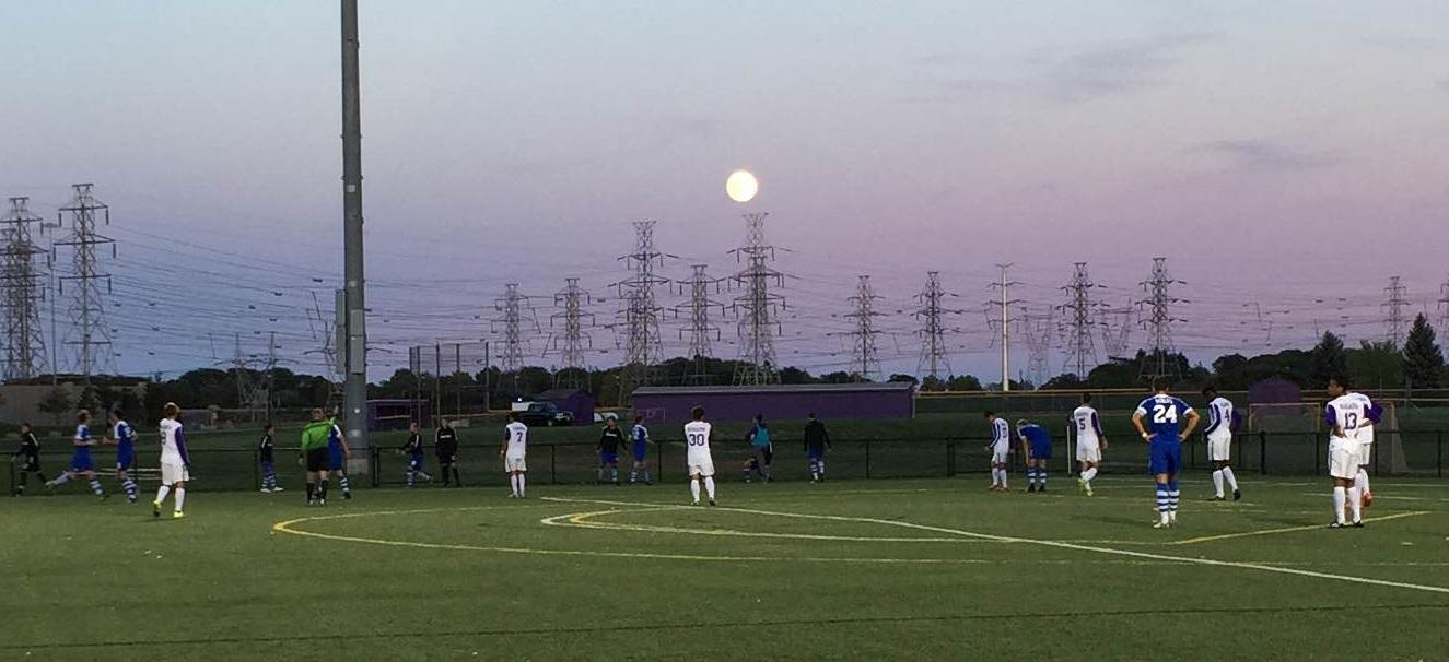 The full moon looms over Niagara Field for Purple Eagles vs. Bulls. (Ben Tsujimoto/Buffalo News)