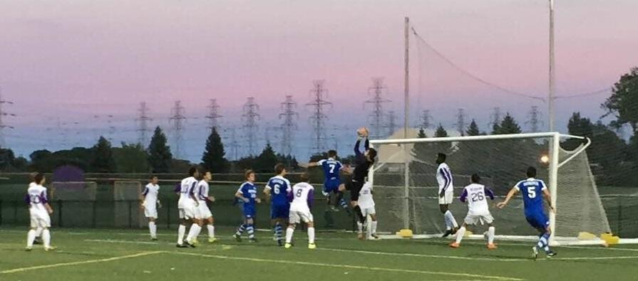 Niagara goalkeeper Steven Casey rises to corral a corner kick before Cicerone can arrive. (Ben Tsujimoto/Buffalo News)