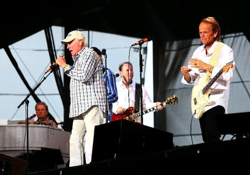 Mile Love performs with the Beach Boys at Darien Lake in 2012, while Brian Wilson looks on. (Robert Kirkham/Buffalo News file photo)
