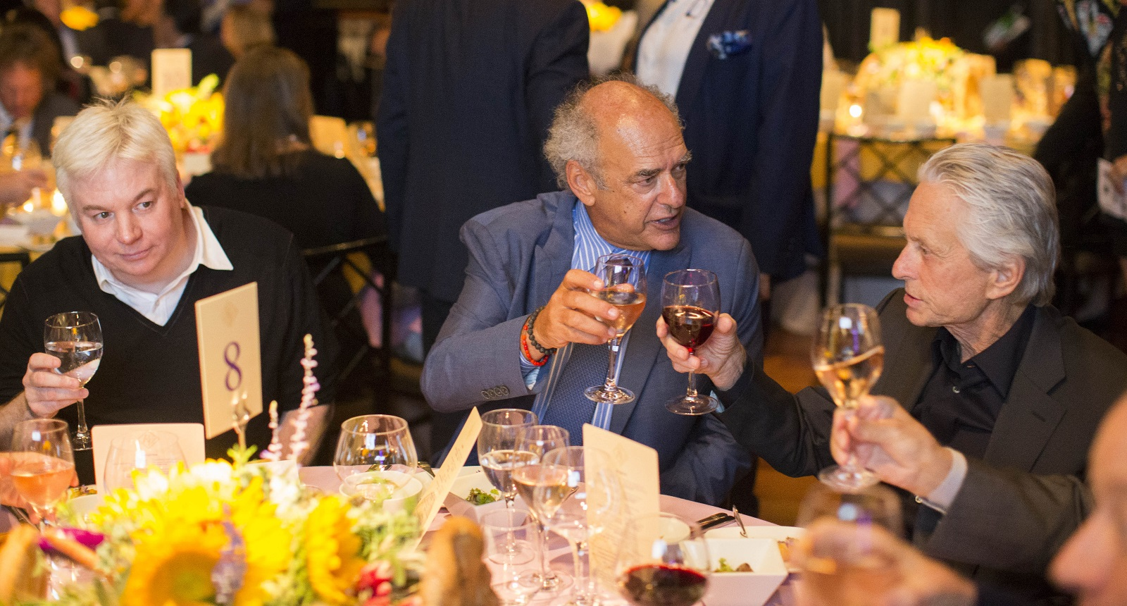 Legendary producer Shep Gordon, center, sits with actors Mike Myers, left, and Michael Douglas, right, during a fundraiser. (Derek Gee/Buffalo News)