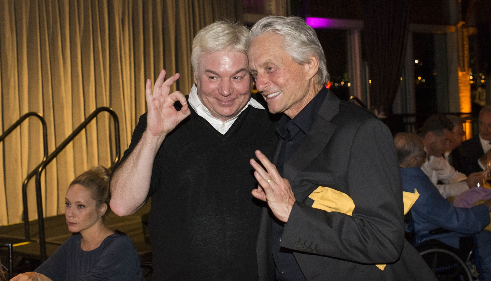 """Actor Mike Myers, left, produced a documentary about Gordon titled """"Supermensch."""" Here, Myers stands with fellow actor Michael Douglas, right, a friend of Gordon's. (Derek Gee/Buffalo News)"""