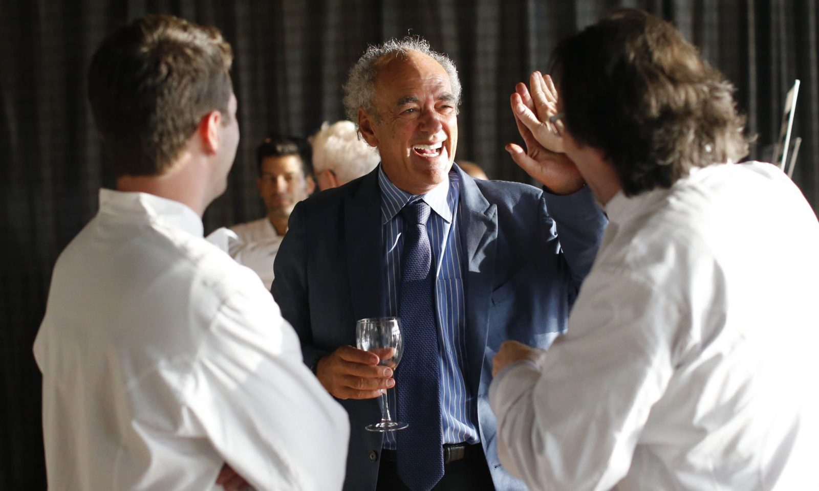 Legendary producer Shep Gordon, center, mingles with celebrity chefs attending a fundraiser he co-hosted to start a scholarship to the Culinary Institute of America in honor of his late friend, legendary chef Roger Verge. (Derek Gee/Buffalo News)