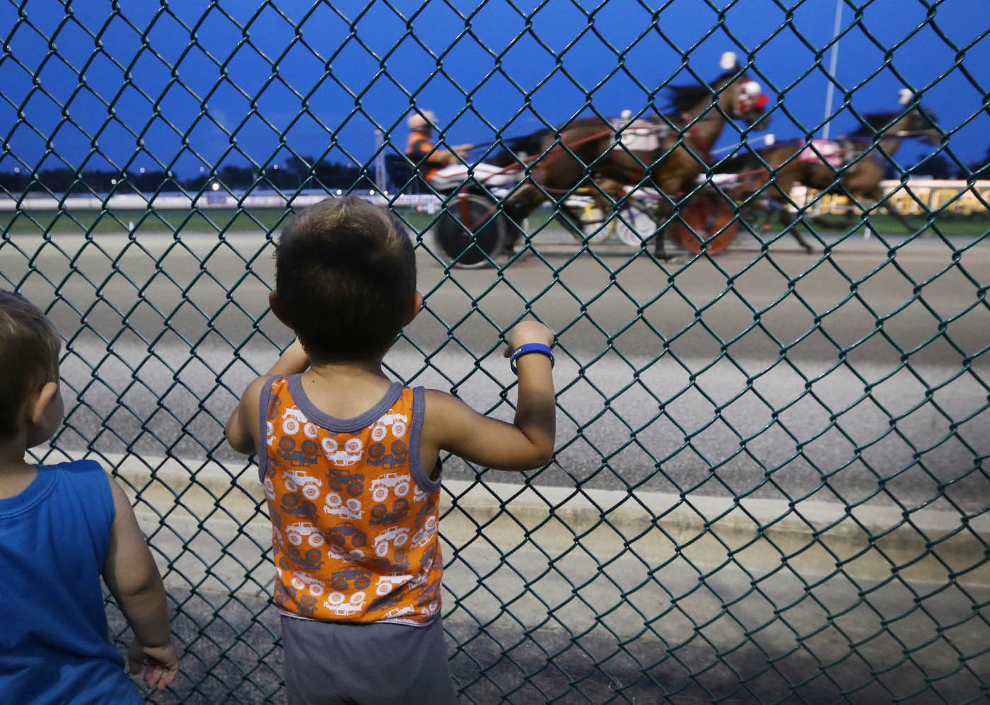 Families and individuals come out for a Wednesday night of horse racing at Batavia Downs, the oldest lighted harness track in the US, Wednesday, Sept. 7, 2016. Kenny Whitcroft, 3, left, and Kevin Horgan, 2, watch their great uncle race. (Sharon Cantillon/Buffalo News)
