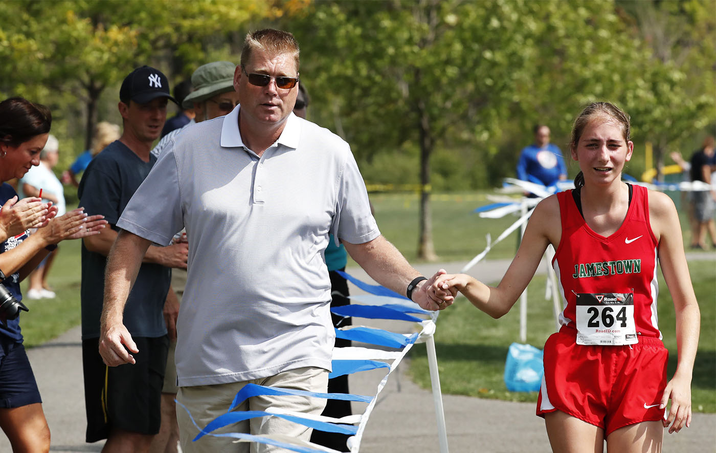 Pictures, Walter Hoss holds his daughter, Nicole's hand as they walk to the the finish line as she overheated as she competed in the large schools girls cross country meet at Sunshine Park in West Seneca on Saturday, Sept. 10, 2016. (Harry Scull Jr./Buffalo News)