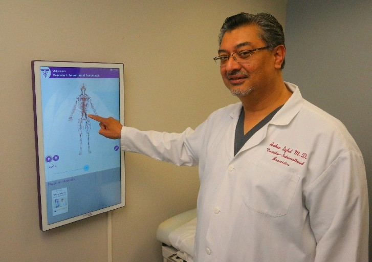 "It used to be that with other methods, treatment of ulcers might last months, maybe even years. This way, patients can get better in a matter of a few weeks, depending on the severity of their wound. – Dr. Azher Iqbal, demonstrating a touch-screen ""anatomy board."""