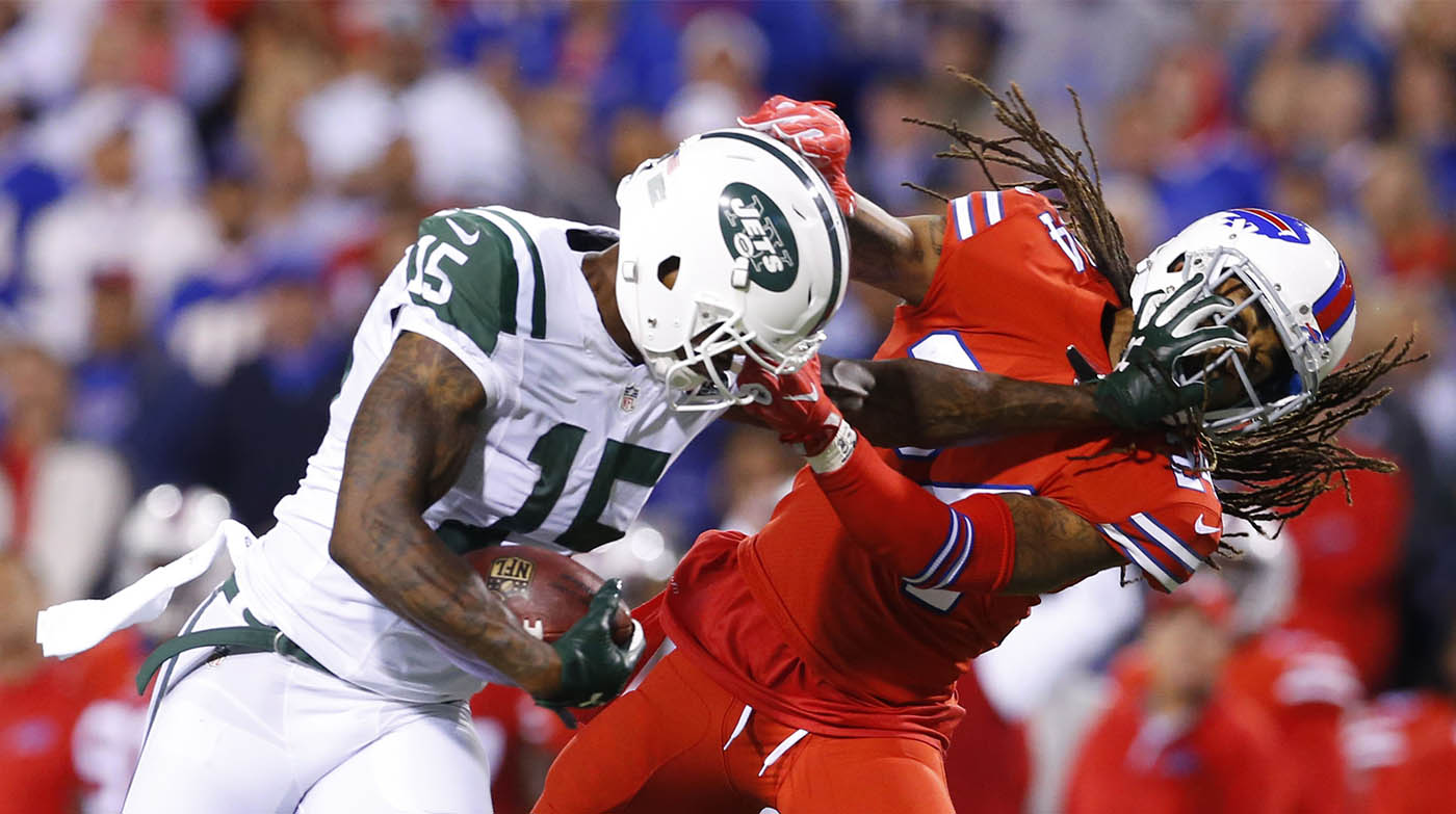 Pictures, Buffalo Bills cornerback Stephon Gilmore, right, wraps up New York Jets wide receiver Brandon Marshall (15) during the first quarter at New Era Field in Orchard Park, N.Y. on Thursday, Sept. 15, 2016. (Mark Mulville/Buffalo News)