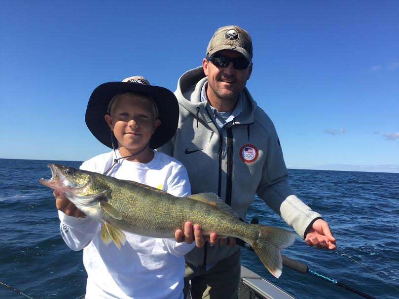 Connor Lupkin and Sabres coach Dan Bylsma with a walleye caught fishing Lake Erie with Capt. Jim Hanley.