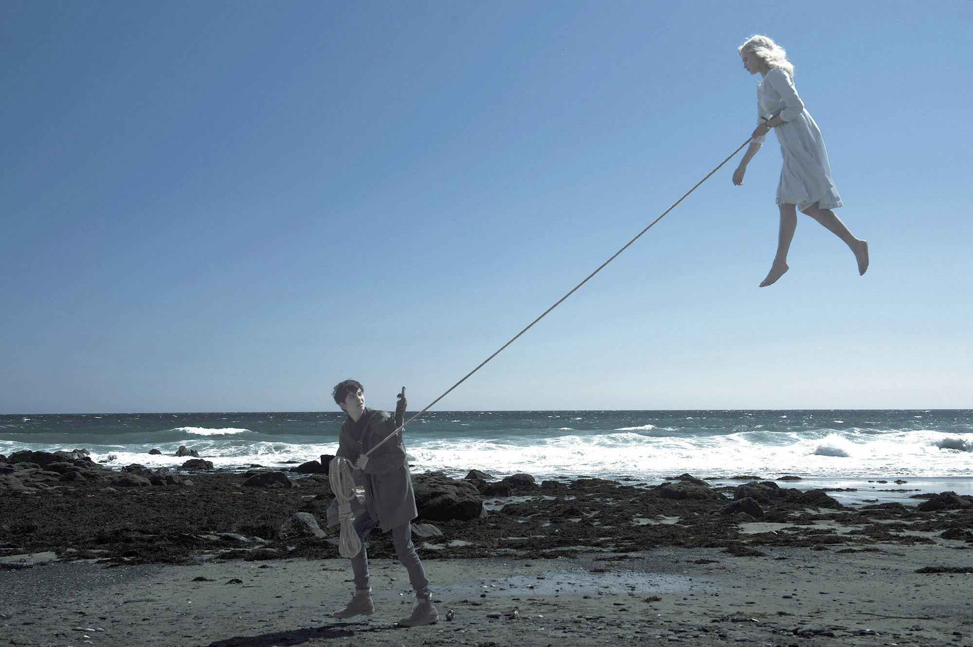 Jake (Asa Butterfield) makes sure Emma (Ella Purnell) stays relatively down to earth in 'Miss Peregrine's Home for Peculiar Children. ( Jay Maidment/ Twentieth Century Fox)