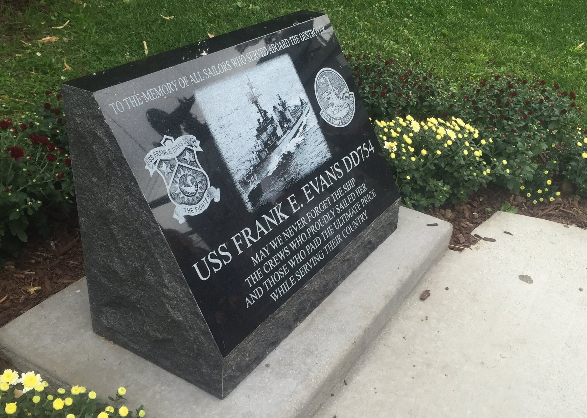 A memorial is placed at the Buffalo & Erie County Naval and Military Park Friday in memory of the three New York State residents who were among the 74 men killed when an allied flagship T-boned their destroyer in the South China Sea in 1969.