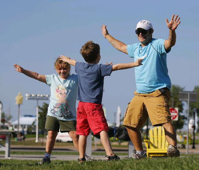 Jeffrey Turcotte leads Exercise Like the An)imals this week at Canalside. (Mark Mulville/Buffalo News)