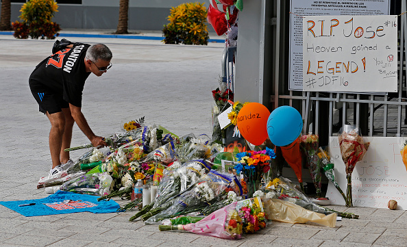 A fan places flowers at  a makeshift memorial that sprouted outside Marlins Park for Jose Fernandez on Sunday (Getty Images).