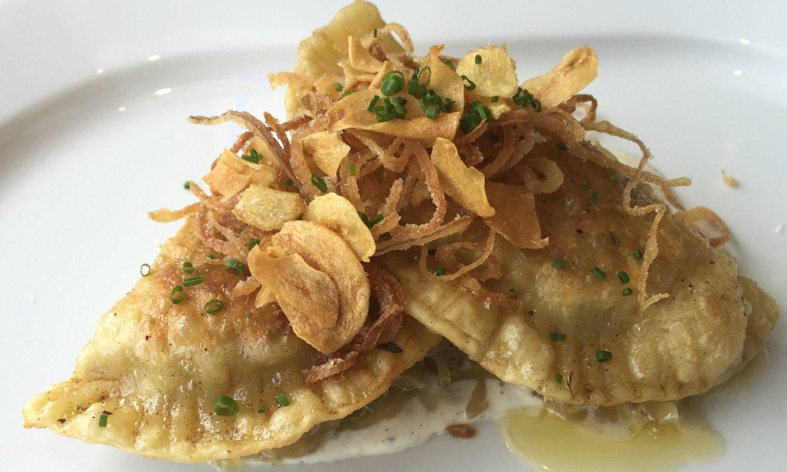 Potato-leek pierogi with fried shallots and garlic, housemade sauerkraut at Patina 250. (Andrew Galarneau/Buffalo News)