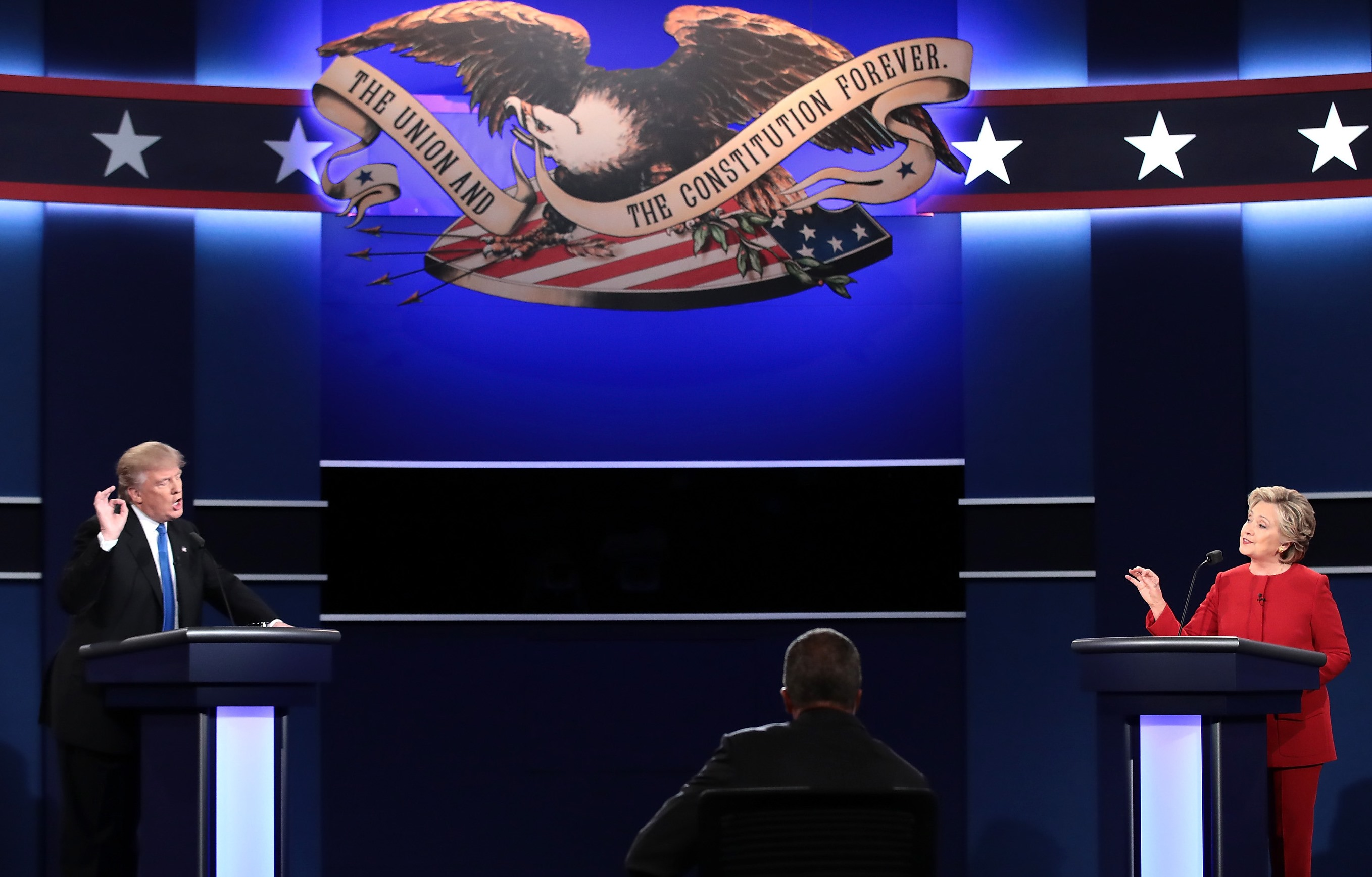 Republican presidential nominee Donald Trump speaks as Democratic presidential nominee Hillary Clinton and moderator Lester Holt listen during the presidential debate at Hofstra University on Sept. 26, 2016, in Hempstead, N.Y. (Getty Images)
