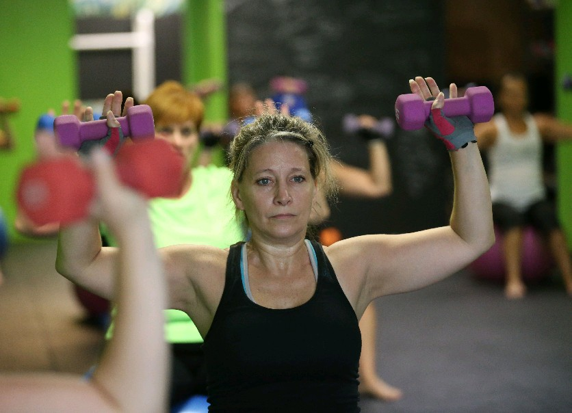 Tracy Gibos participates in a Body Pump class this week at Power Fitness. (Sharon Cantillon)