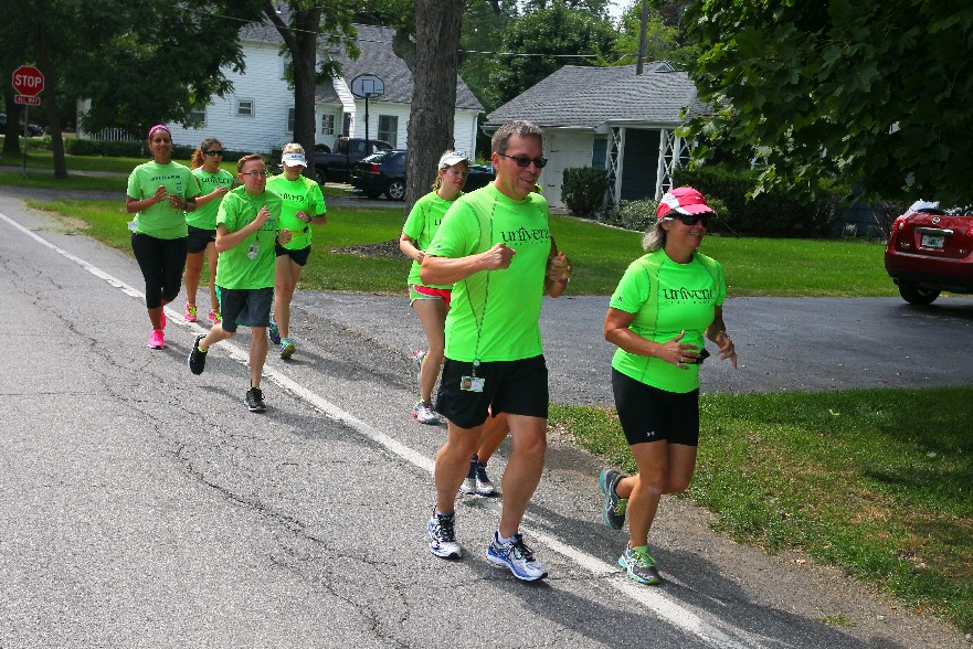 The running club at Univera Healthcare's corporate office in Amherst hits the local roads during lunch hour on Wednesday. (John Hickey/Buffalo News)