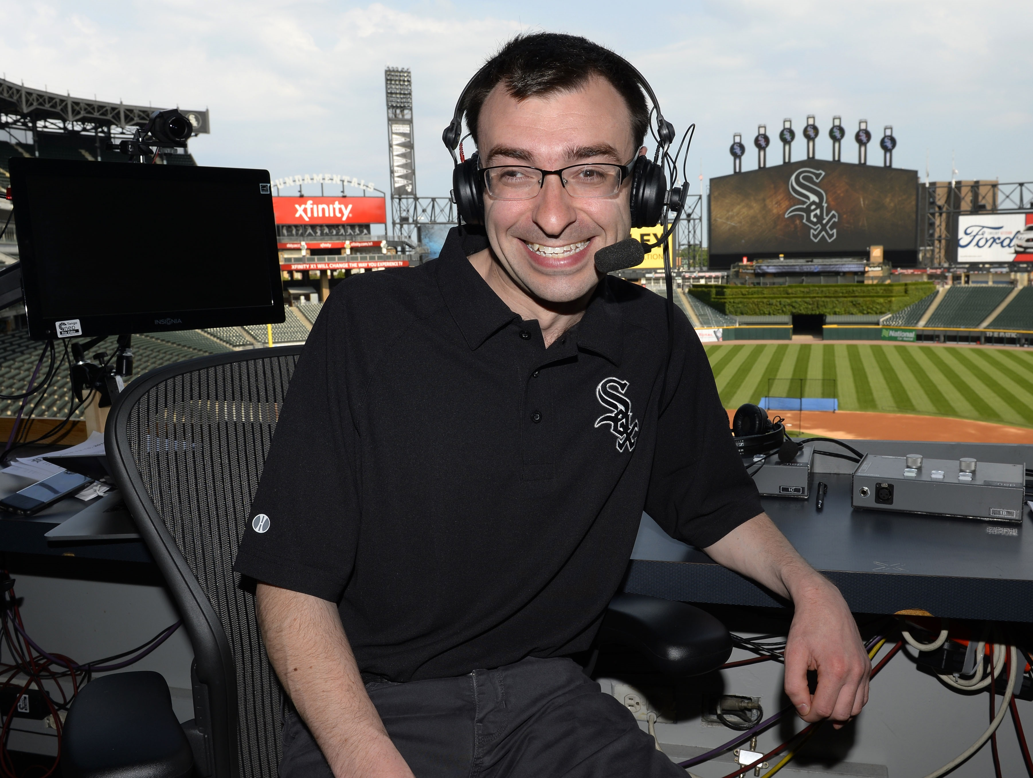 Jason Benetti in the broadcasting booth, Comiskey Park, Chicago. (Photo courtesy Ron Vesely)