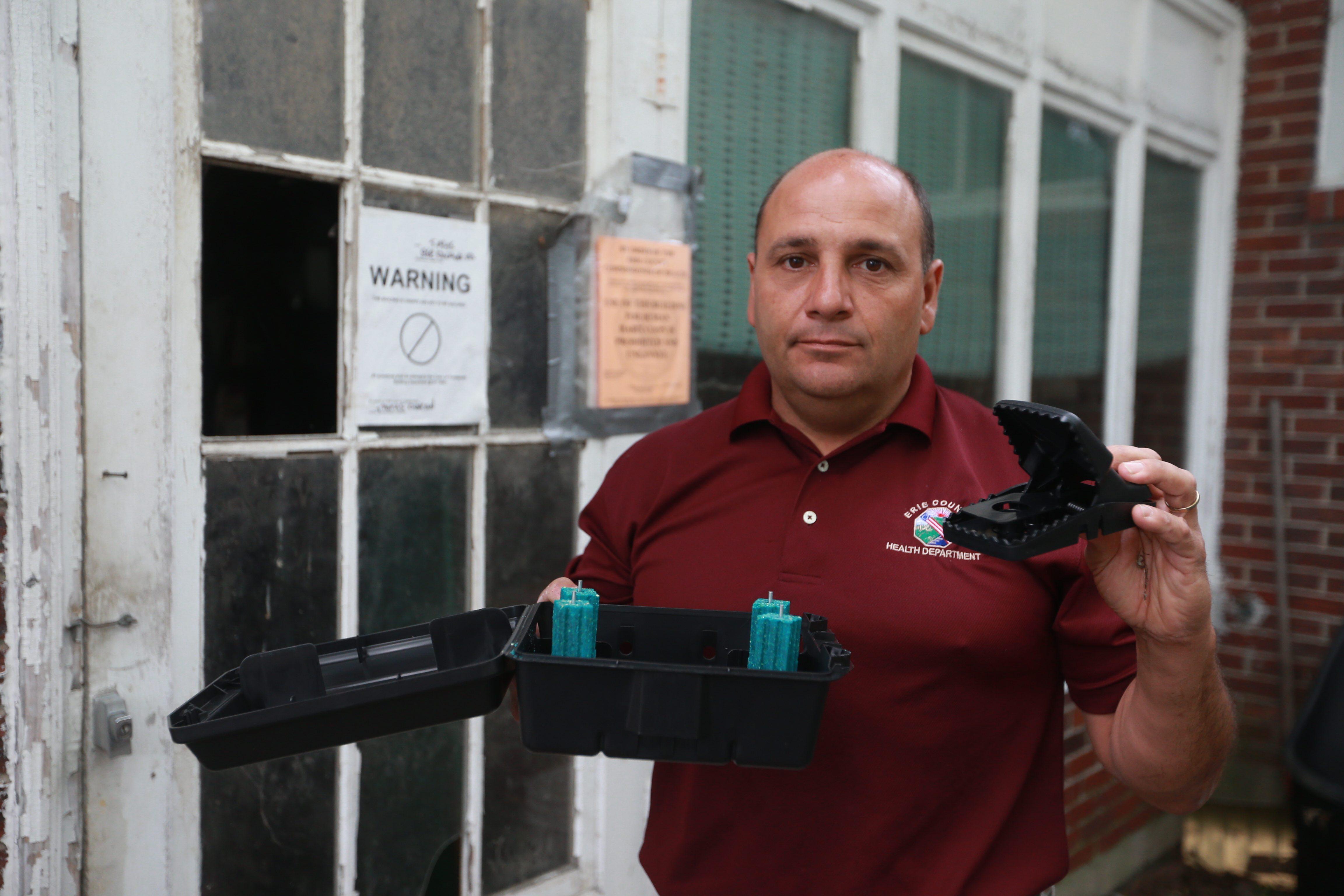 Peter Tripi, a sanitarian for the Erie County Health Department, says one unkept bird feeder can ruin a neighborhood. (John Hickey/Buffalo News file photo)