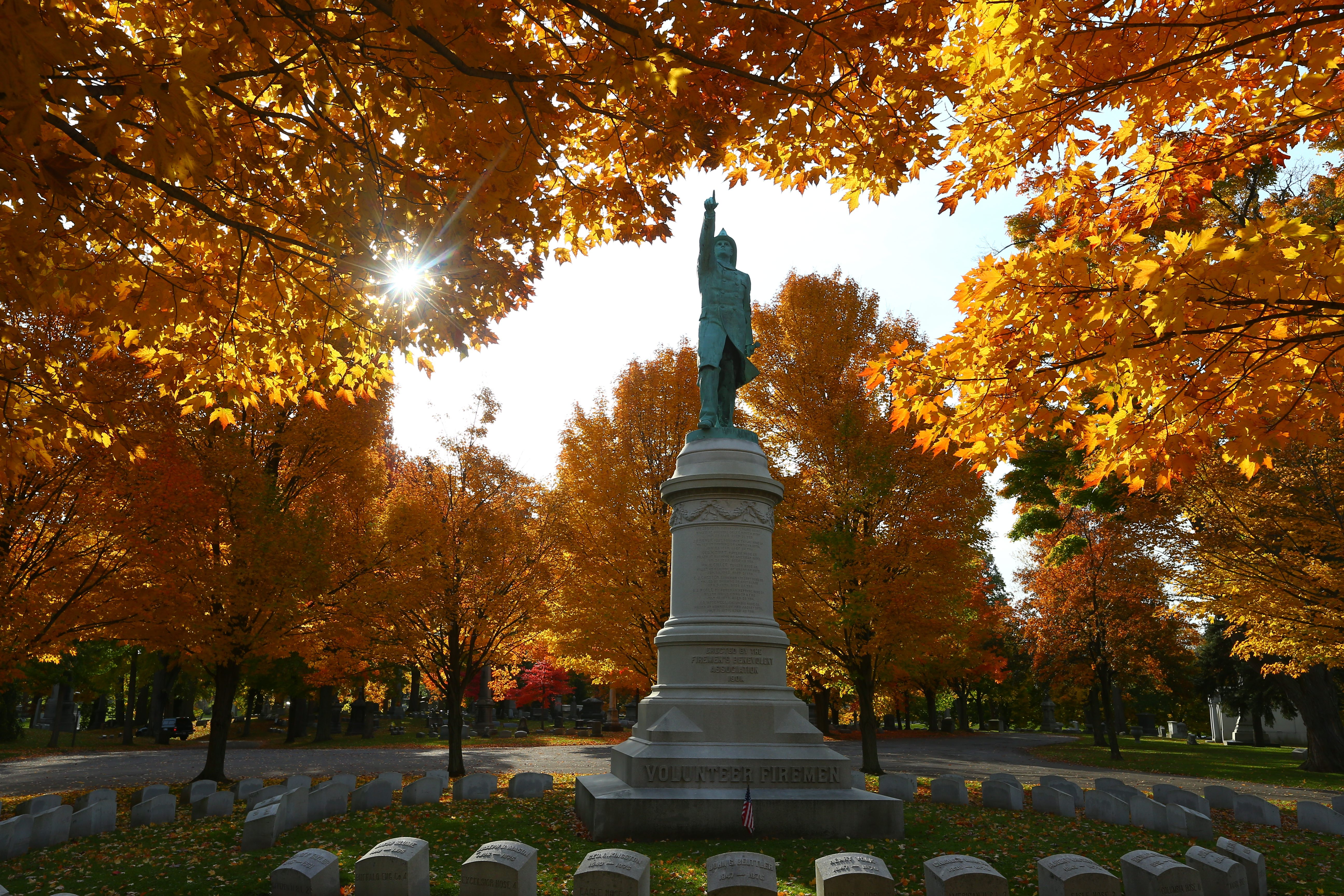 Volunteer firemen monument surrounded by fall foliage on a sunny, 49-degree morning at Forest Lawn Cemetery. (John Hickey/Buffalo News)