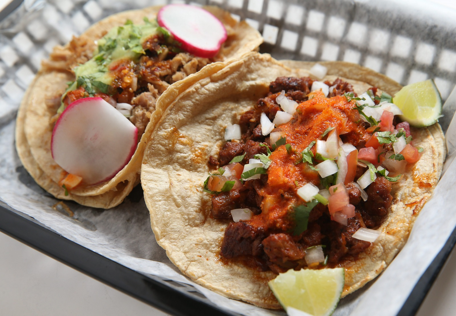 La Divina Dos offers tacos like carnitas (left) and al pastor (right)(Sharon Cantillon/Buffalo News)