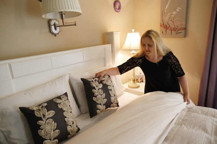 Salina Smouse makes up a bed in a guest room at the Butler House Bed and Breakfast in Niagara Falls in this June 26, 2016, file photo. The Butler House takes a small percentage of its bookings from Airbnb. (Derek Gee/Buffalo News)