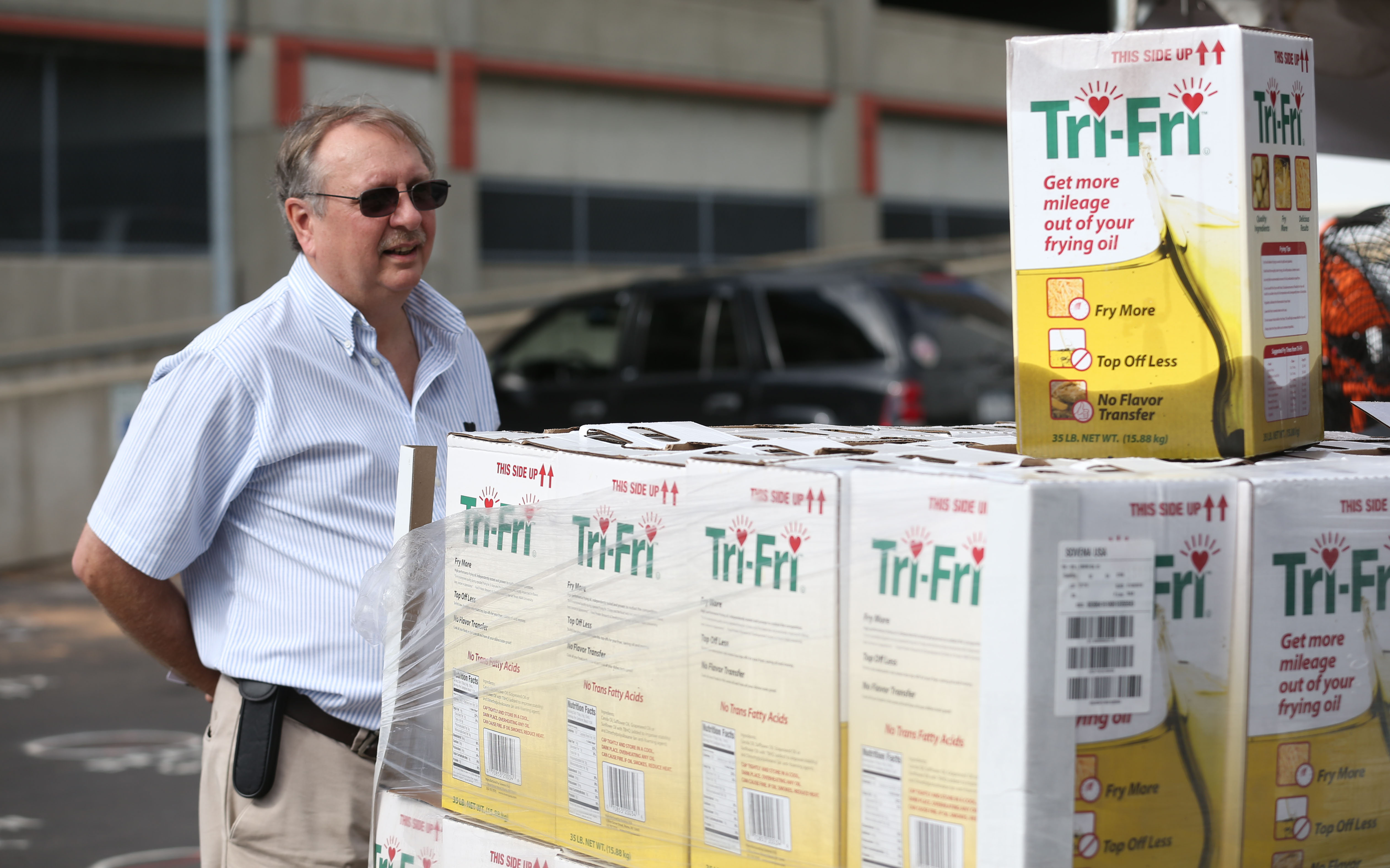 Mark Kowalski, the deputy director of Environmental Health for the county health department, looks over some of the supply of oil used to fry the wings as his inspectors fanned out at Wing Fest. (Sharon Cantillon/Buffalo News)