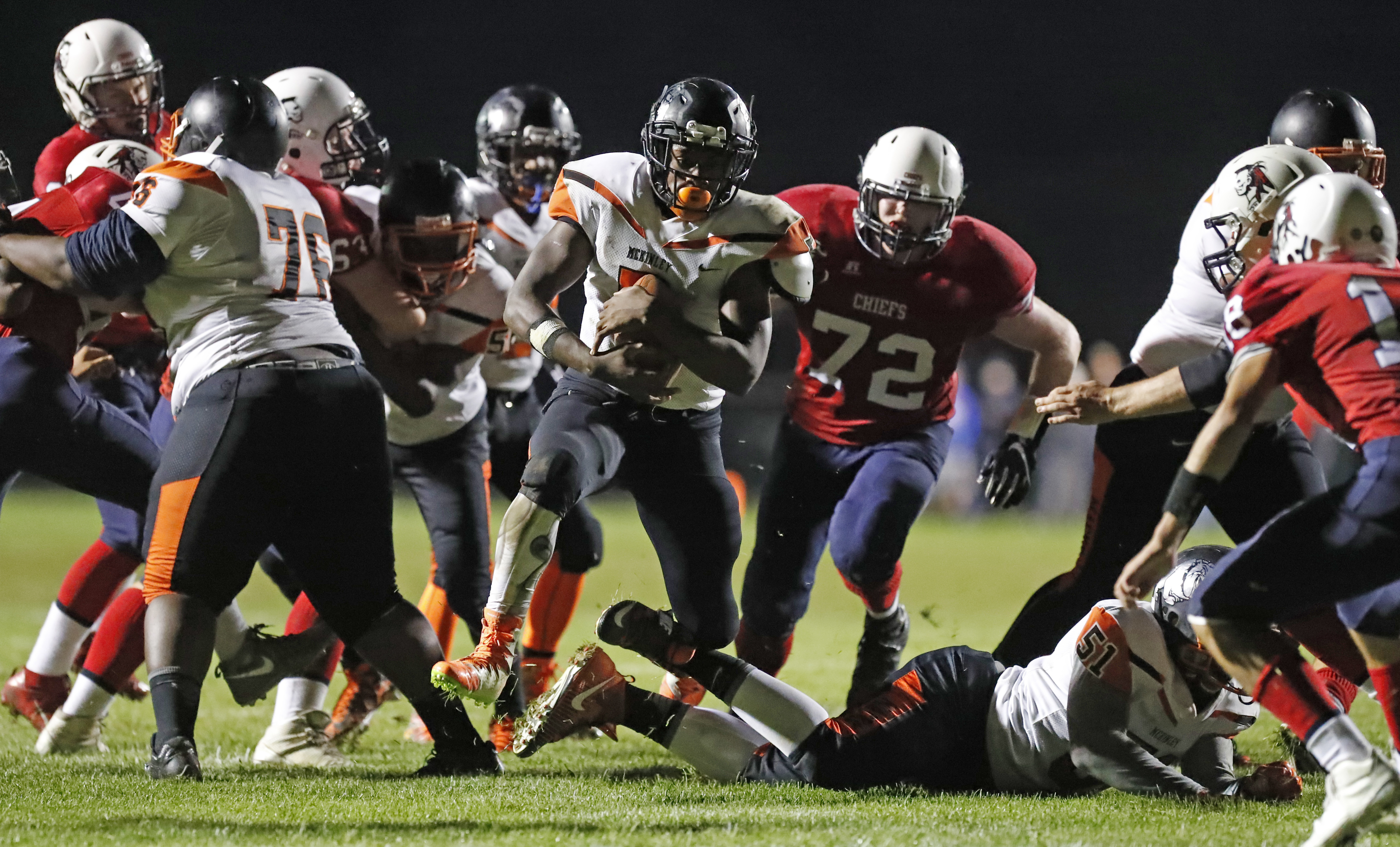 Kaiyer Fields rushes for one of his team-leading  10 touchdowns for McKinley during a Week Four win at Iroquois -- one of five straight games the Macks have won to overcome a 0-2 start.  (Harry Scull Jr./Buffalo News)