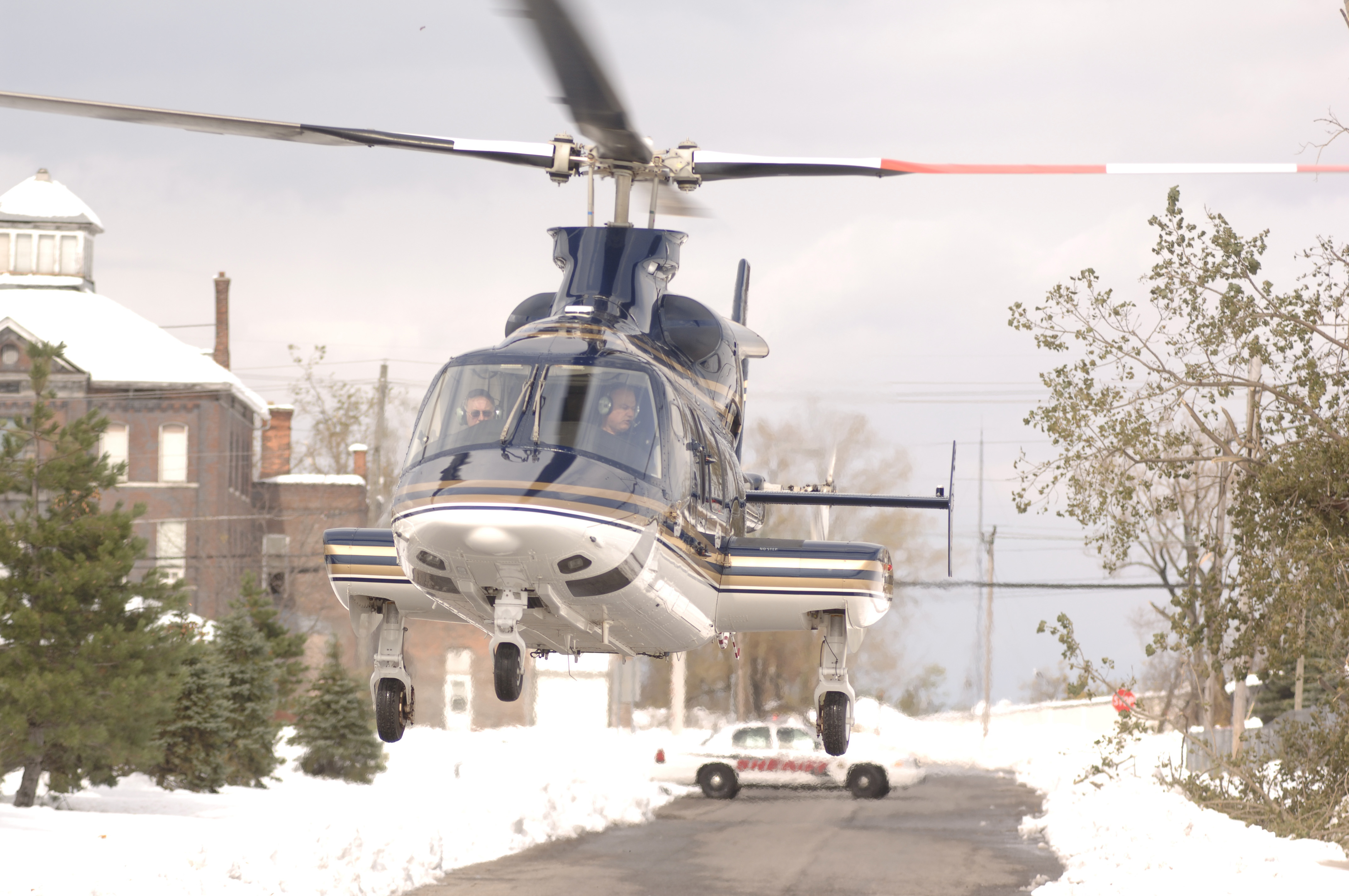 A state police helicopter carrying Gov. George Pataki, County Executive Joel Giambra, Mayor Byron Brown and Rep. Tom Reynolds takes off outside the Erie County Emergency Services Operations Center in Cheektowaga to survey damage from the freak October snow storm in 2006.  (Derek Gee/News file photo)