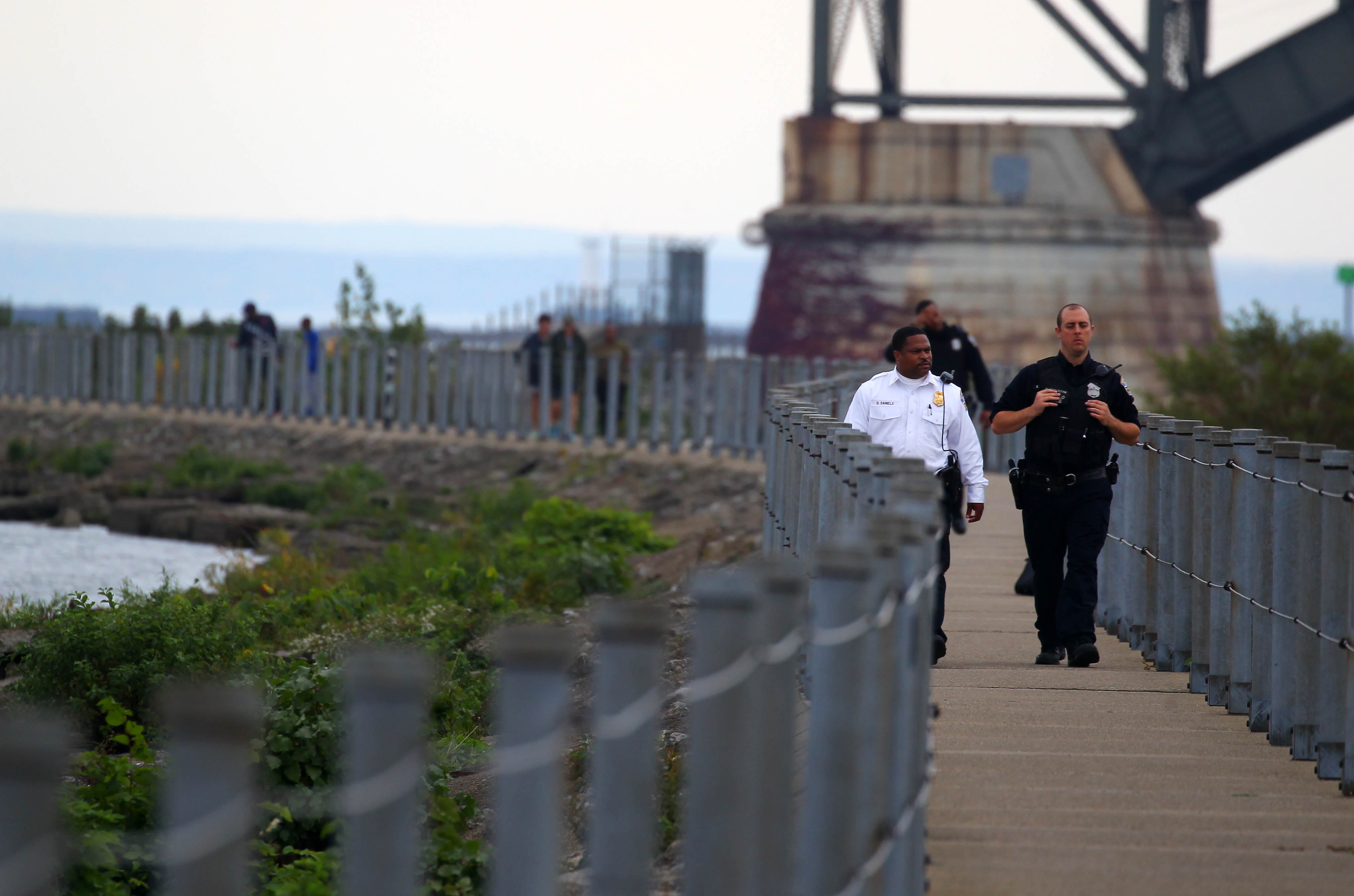 Buffalo Police investigate a body found on the Bird Island Pier Monday, Oct. 17, 2016. People who die outside of hospitals and nursing homes wind up under the purview of the Erie County Medical Examiner's Office, which has seen a dramatic rise in autopsy cases.   (Mark Mulville/The Buffalo News)