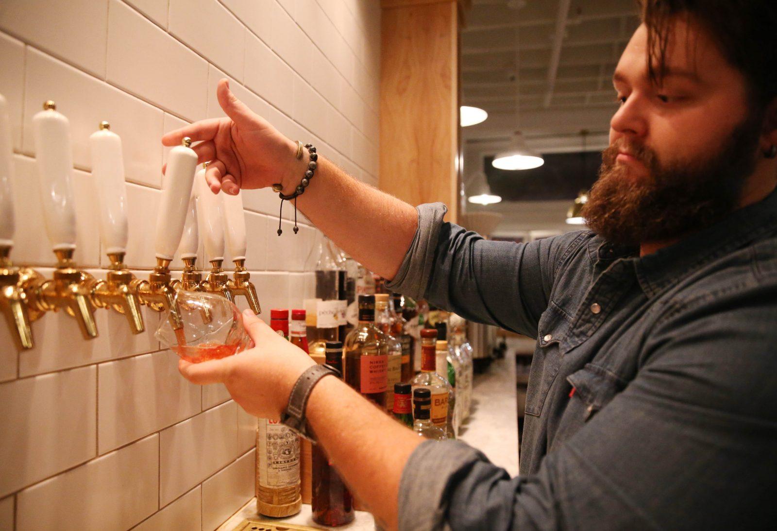 Bar Manager Adam Lauer pours Leonard Oakes Steampunk cider at The Grange in Hamburg.  (Sharon Cantillon/Buffalo News)