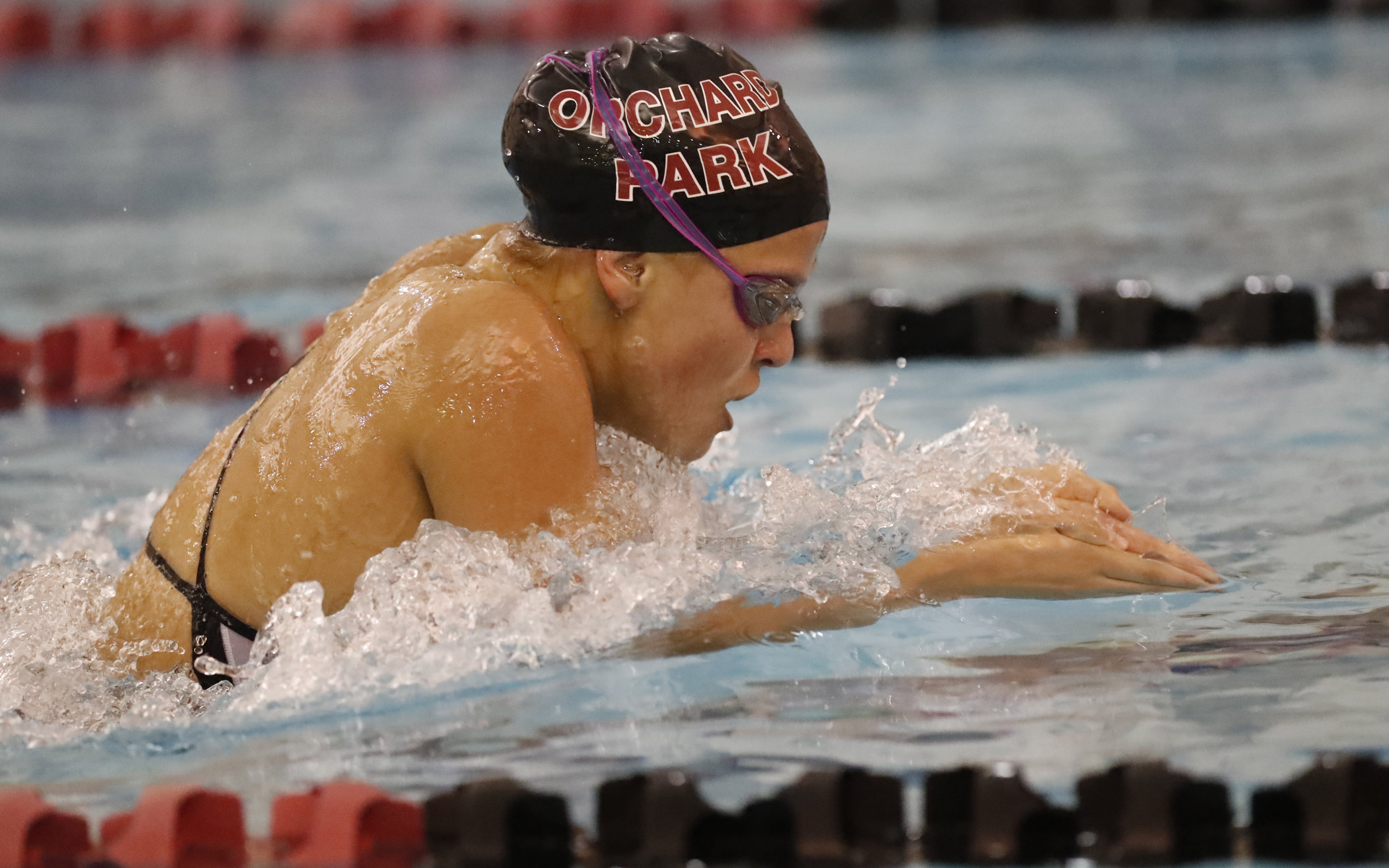 Orchard Park's Olvia Sapio swims to a first-place finish in the 200 individual medley with a time of 2:09.05 in a meet against Clarence on Tuesday. (Harry Scull Jr./Buffalo News)