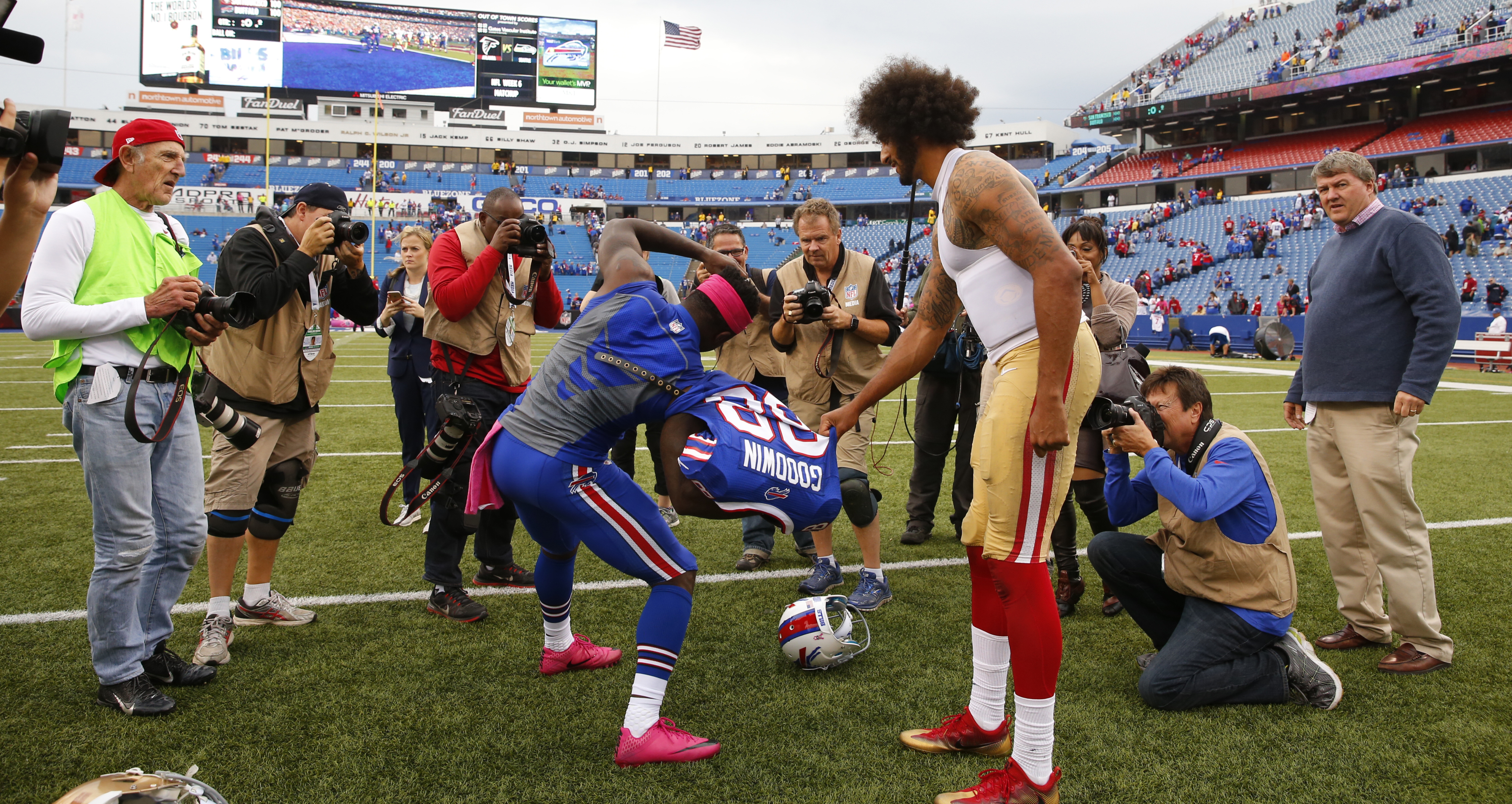 Bills wide receiver Marquise Goodwin and 49ers quarterback Colin Kaepernick trade jerseys after the game. (Harry Scull Jr./Buffalo News)