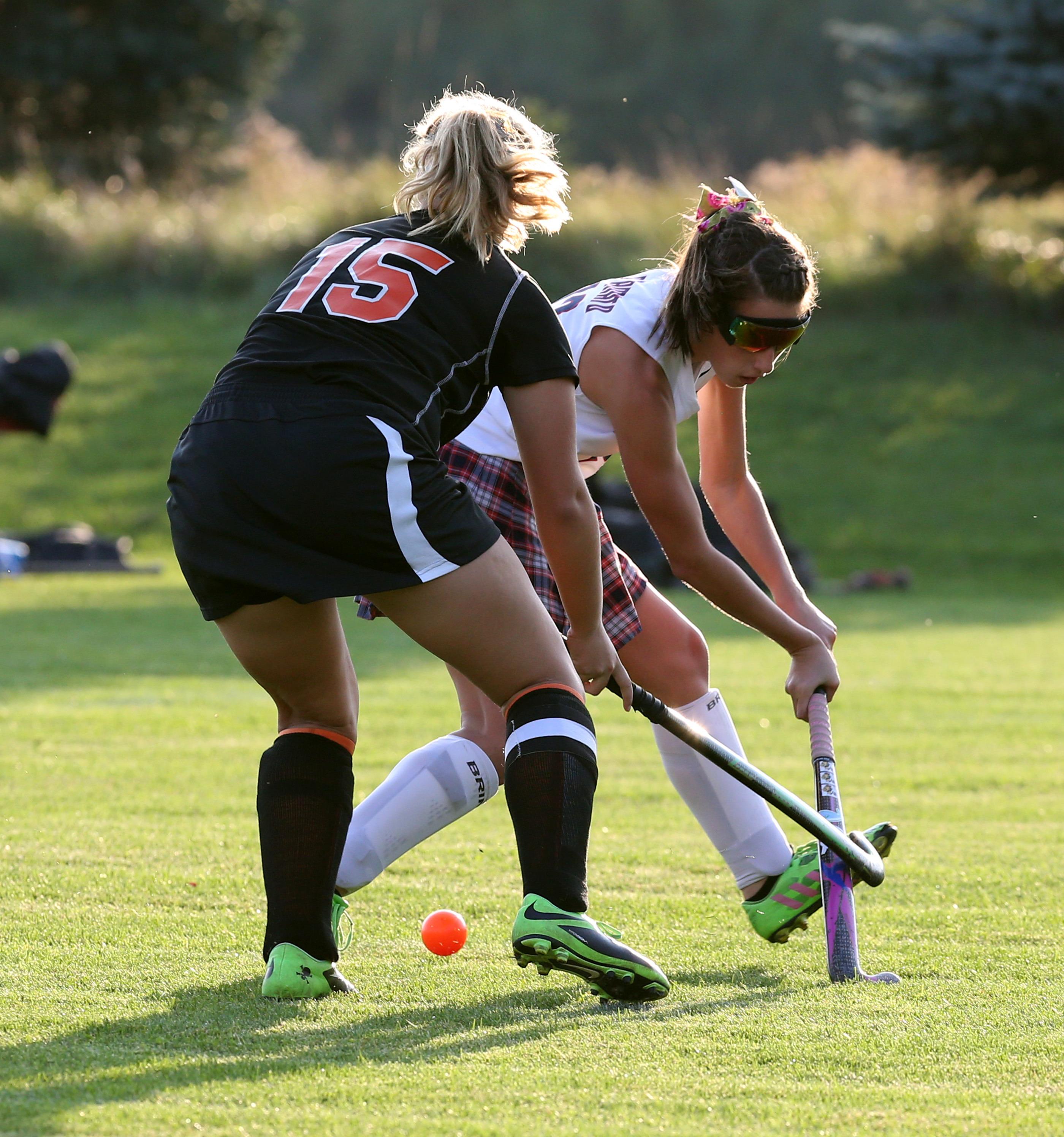 Olivia D'Amato of Iroquois battles Amherst's Lindsey Hoak for the ball (James P. McCoy/ Buffalo News)