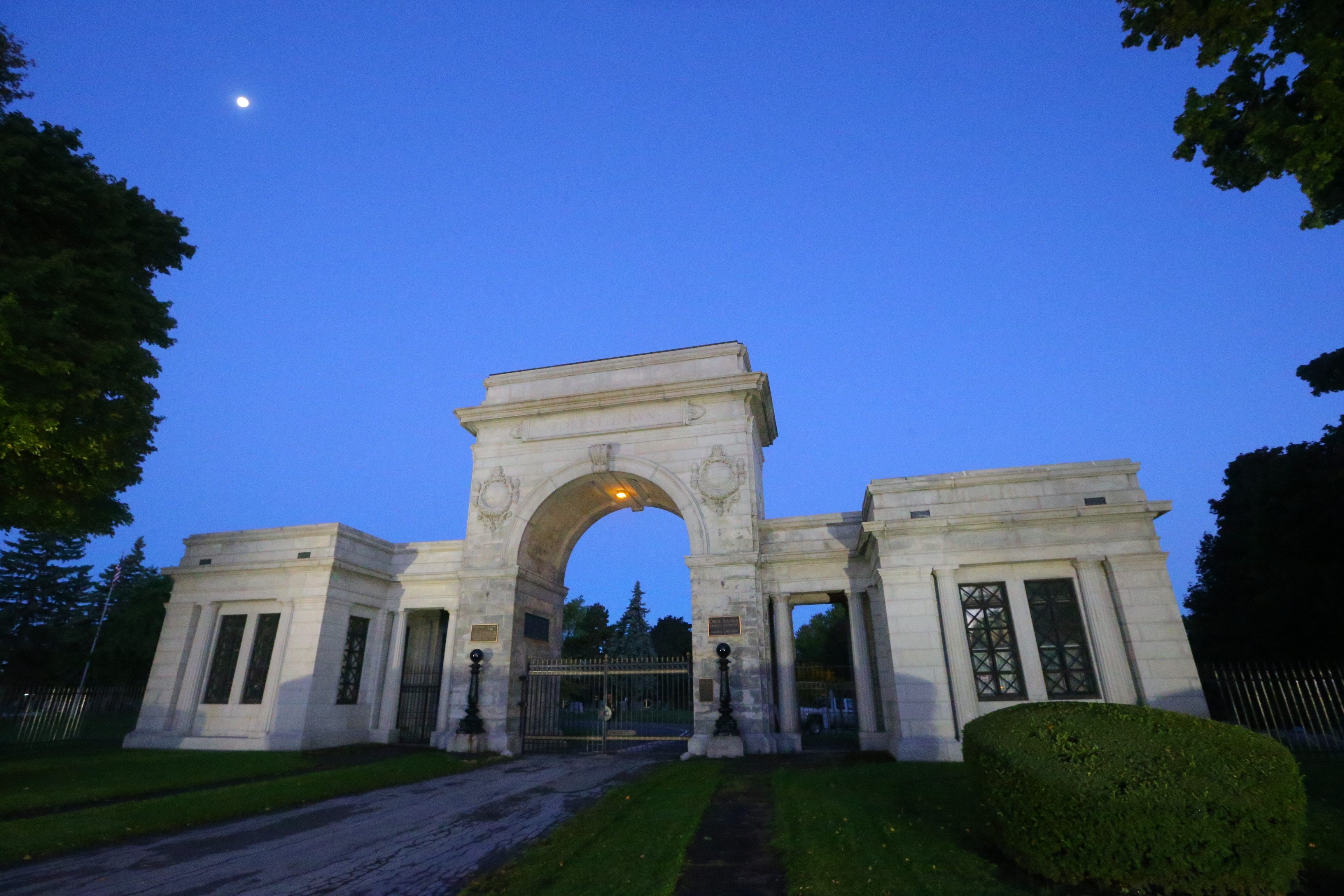 Andy Howard, a groundskeeping supervisor opens the Main Street gate at Forest Lawn Cemetery. (John Hickey/Buffalo News)