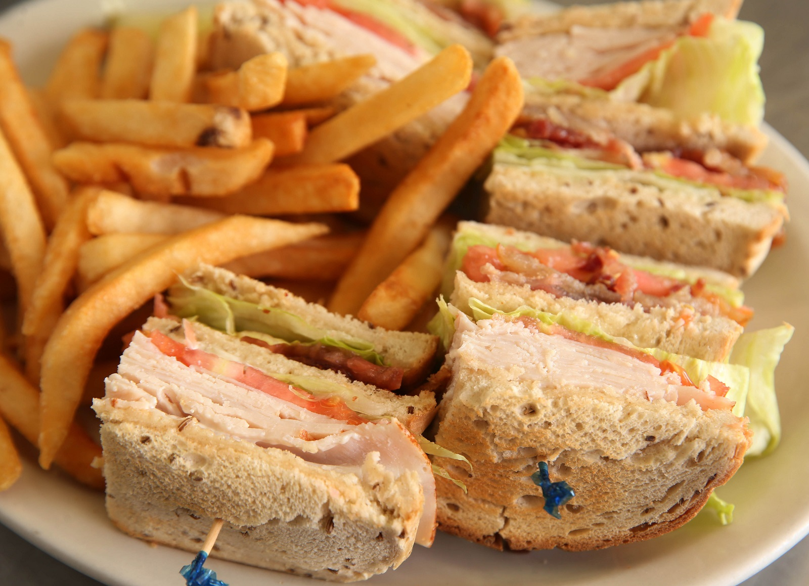The Edge of Town's turkey club on rye with fries. (Sharon Cantillon/Buffalo News)