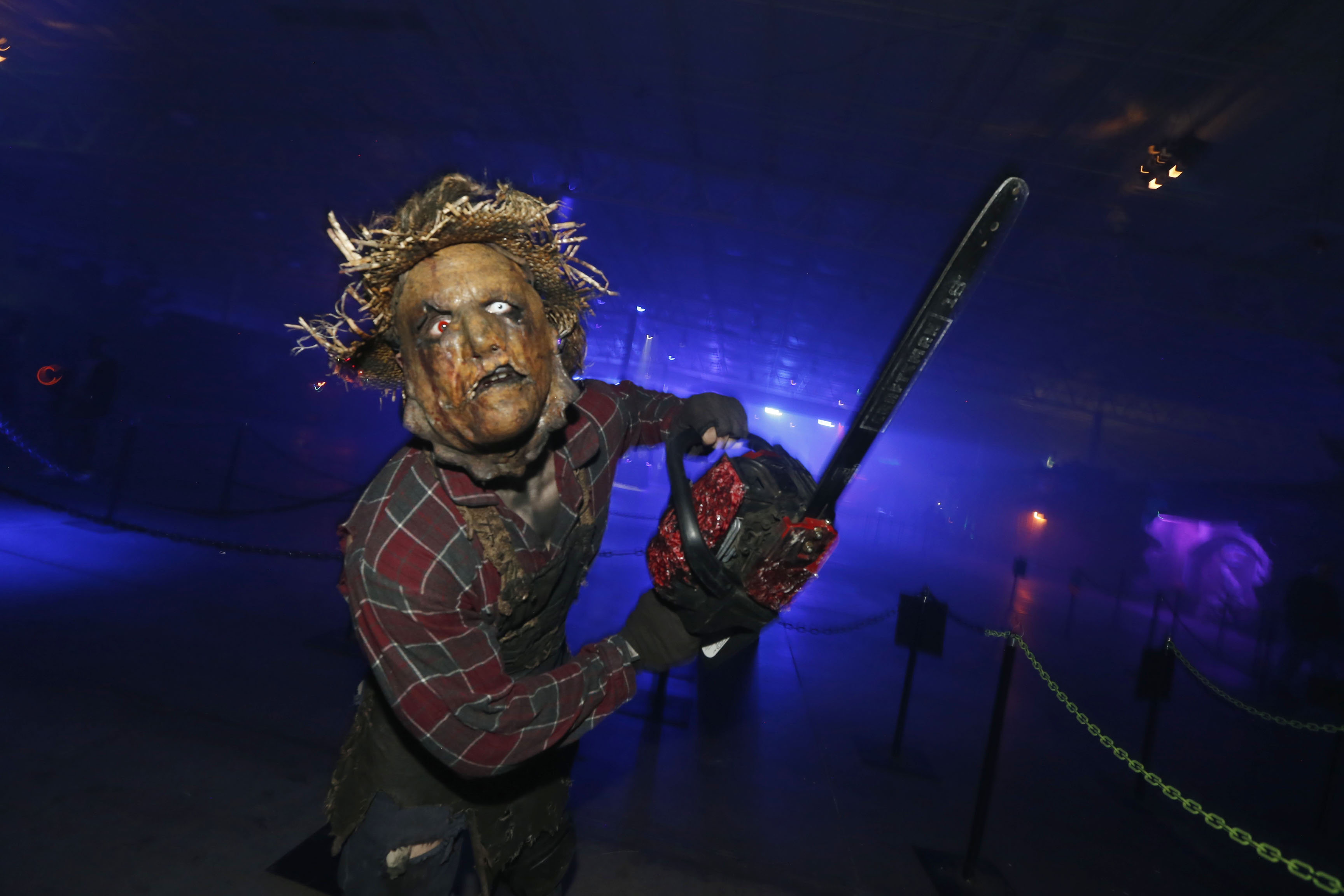 Chainsaw maniac Trevor Feger of Amherst is a crowd pleaser as he has customers running for the exits at Frightworld in Tonawanda. (Robert Kirkham/Buffalo News)