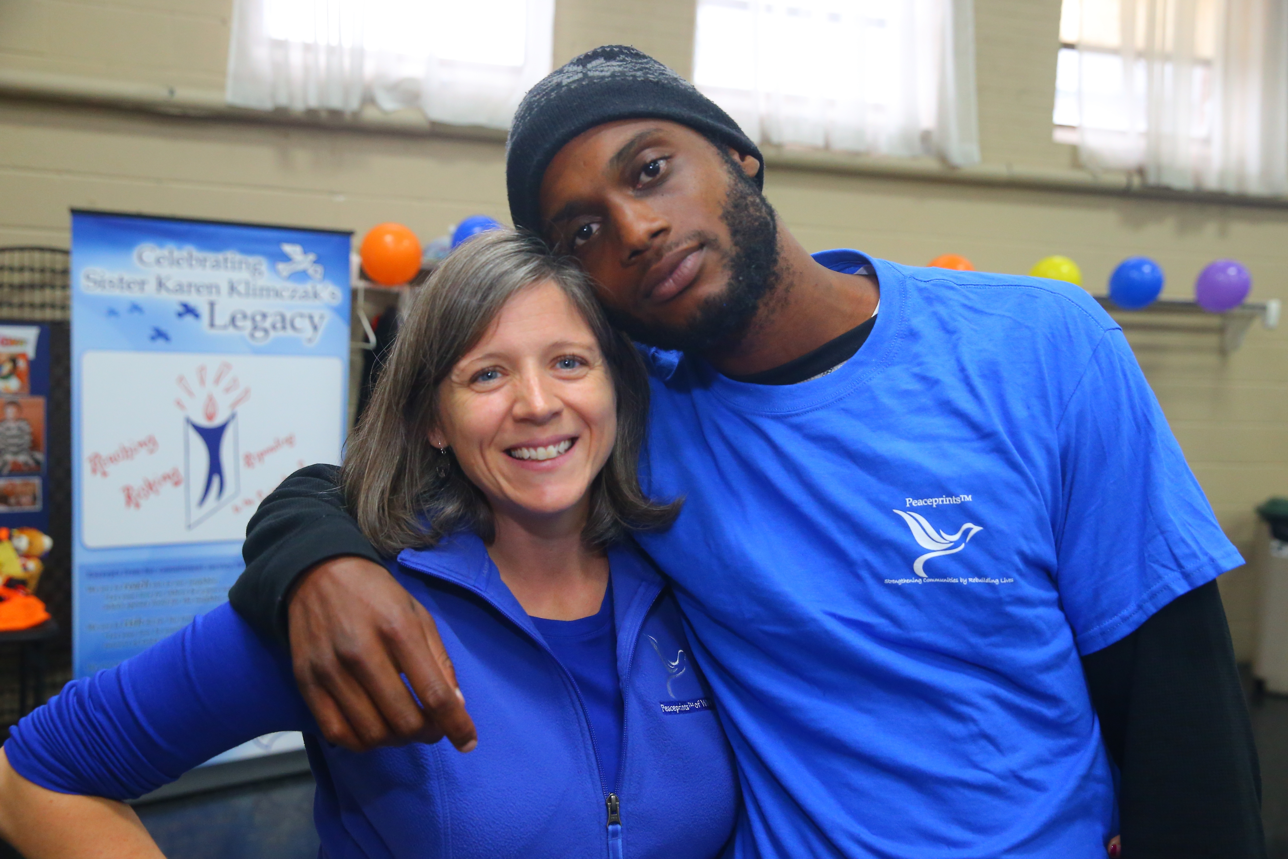 Cindy McEachon , executive director, left and Jamal Johnson at a free community party to commemorate the 10th anniversary of slaying of Sister Karen Klimczak at Ephesus Ministries Parish Hall in Buffalo on Sunday Oct. 30, 2016. (John Hickey/Buffalo News)