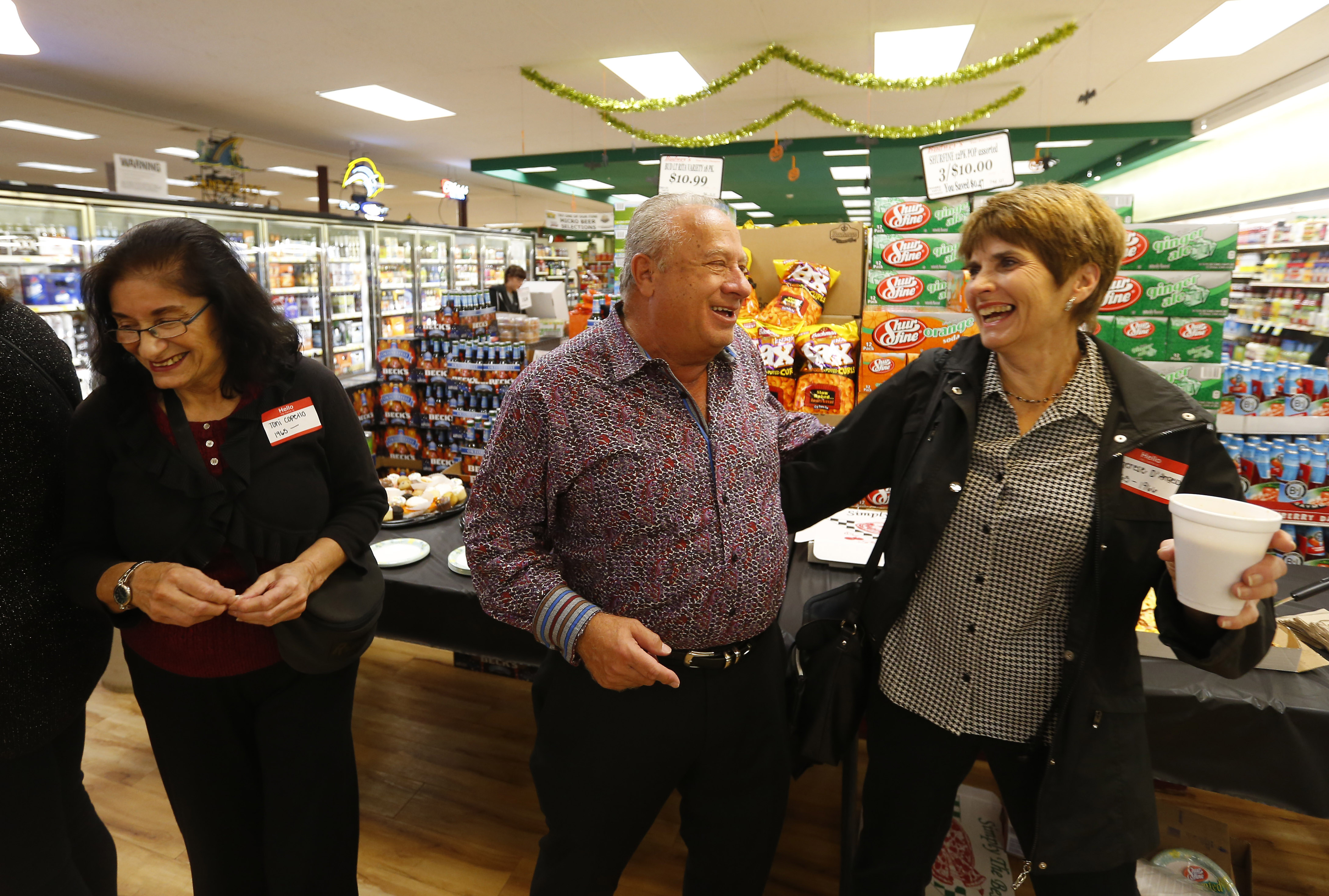 Frank Budwey has a laugh with former employee Therese D'Angelo during a reunion of former employees at the store in North Tonawanda on Saturday, Oct. 30, 2016. (Mark Mulville/Buffalo News)