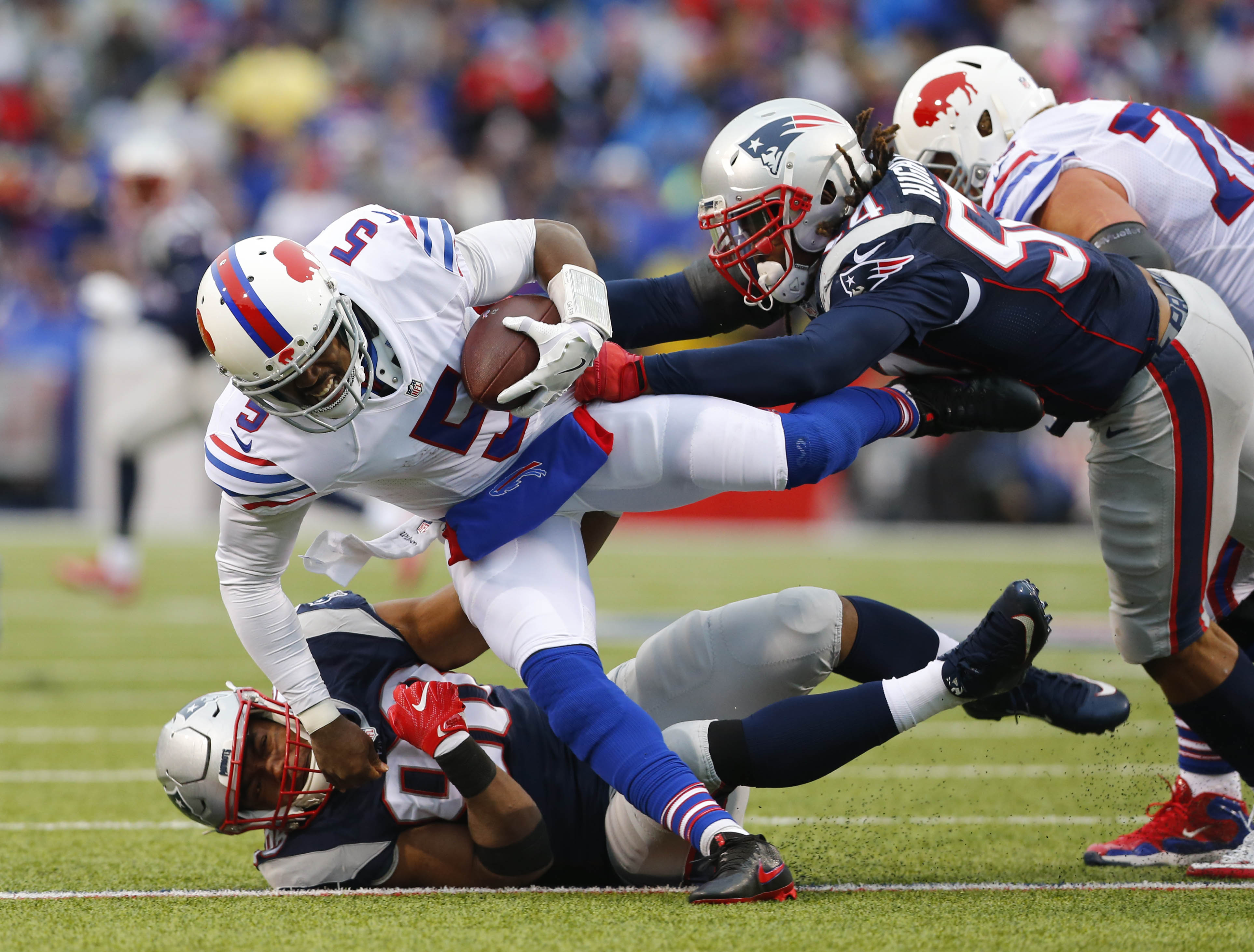 Buffalo Bills quarterback Tyrod Taylor (5) gets tackled by New England Patriots Malcom Brown (90) and Dont'a Hightower (54) during the third quarter.   (Mark Mulville/Buffalo News)