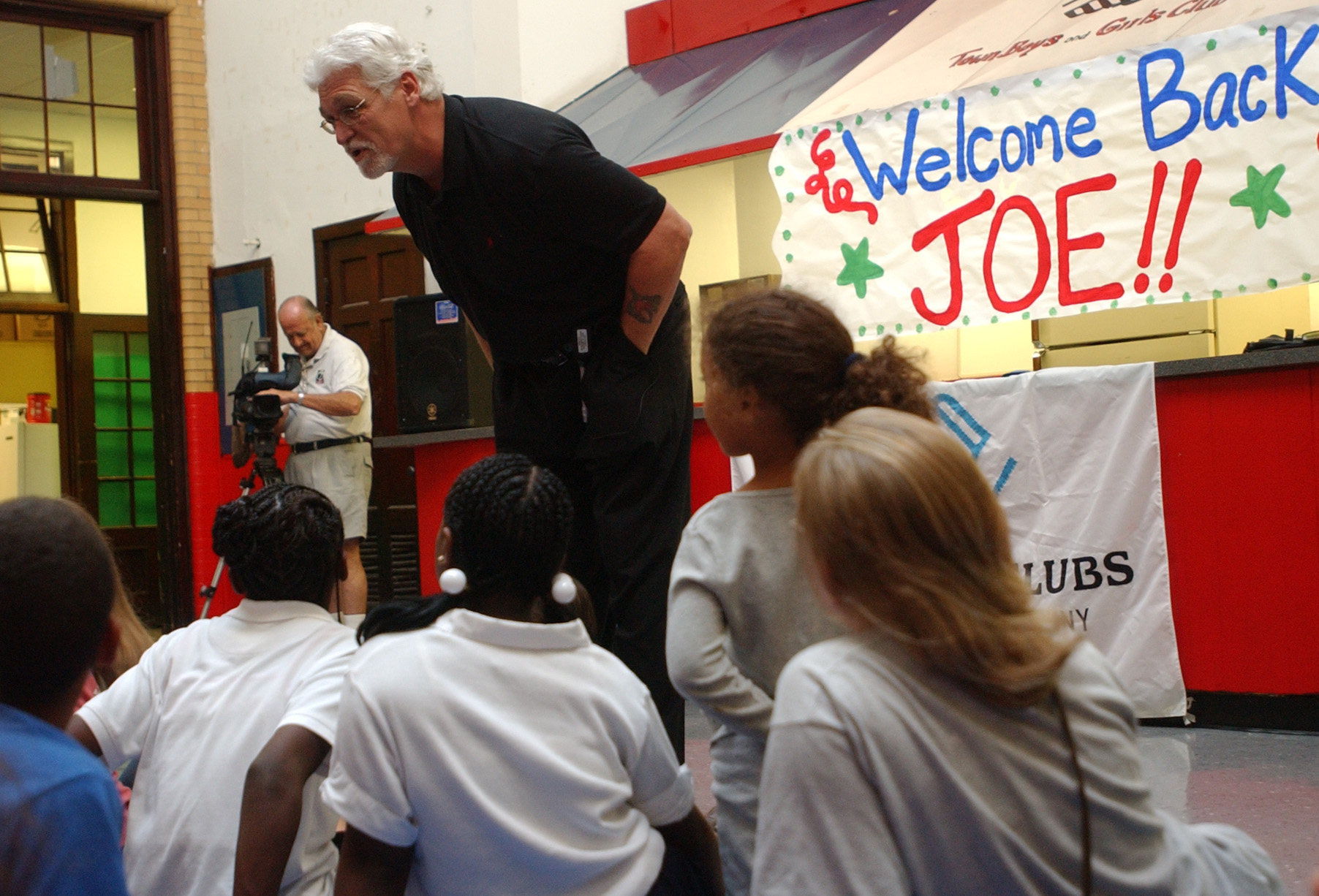 Joe Ehrmann, shown here during a 2005 visit to the Boys and Girls Club on Riverdale Avenue, finds in Donald Trump's hash words toward women, 'a teachable moment.' (Derek Gee/News file photo)