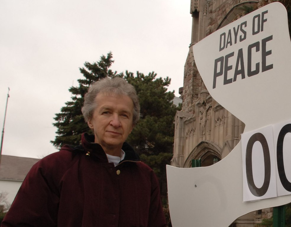 A 2005 photo of Sister. Karen Klimczak,director of the Bissonette House on Grider Street, with her dove countdown sign about Buffalo homicides. (News file photo)